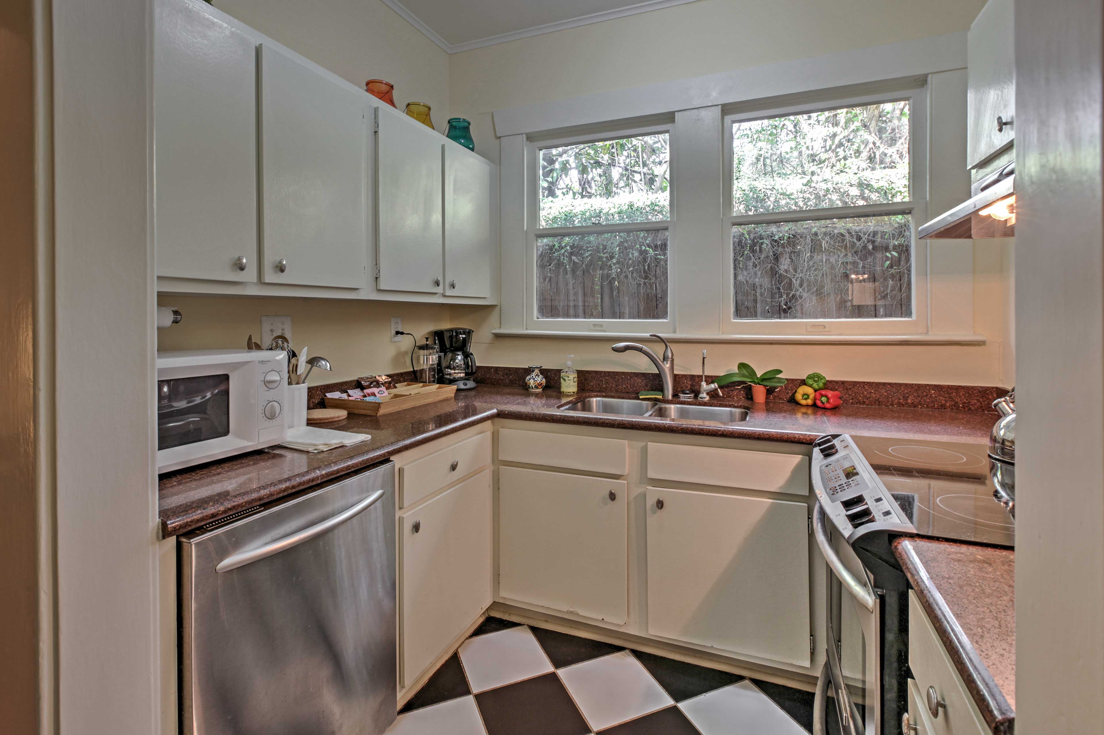 The fully equipped kitchen is stocked with all the necessary cooking gadgets.
