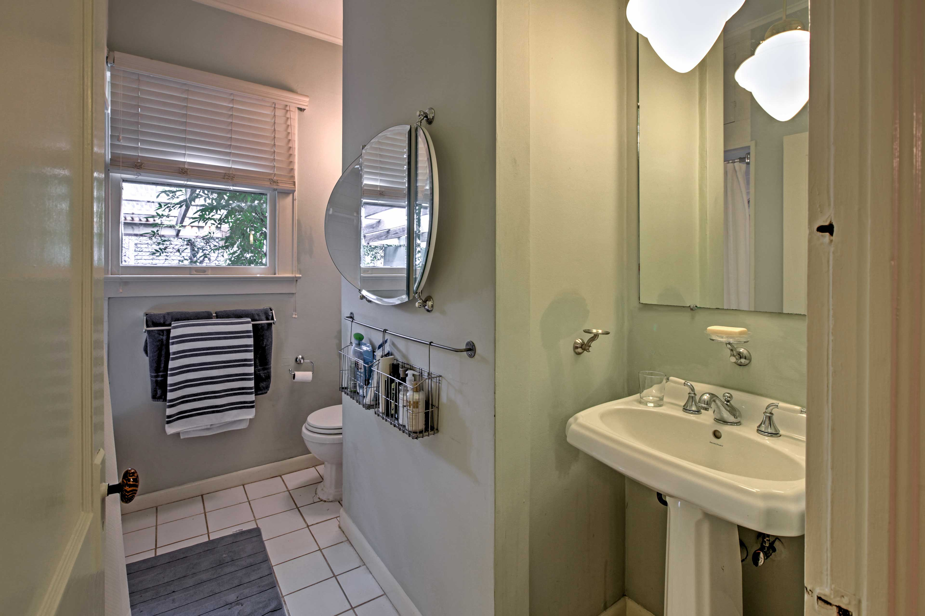 Get ready for a night out on the town in the pristine bathroom.
