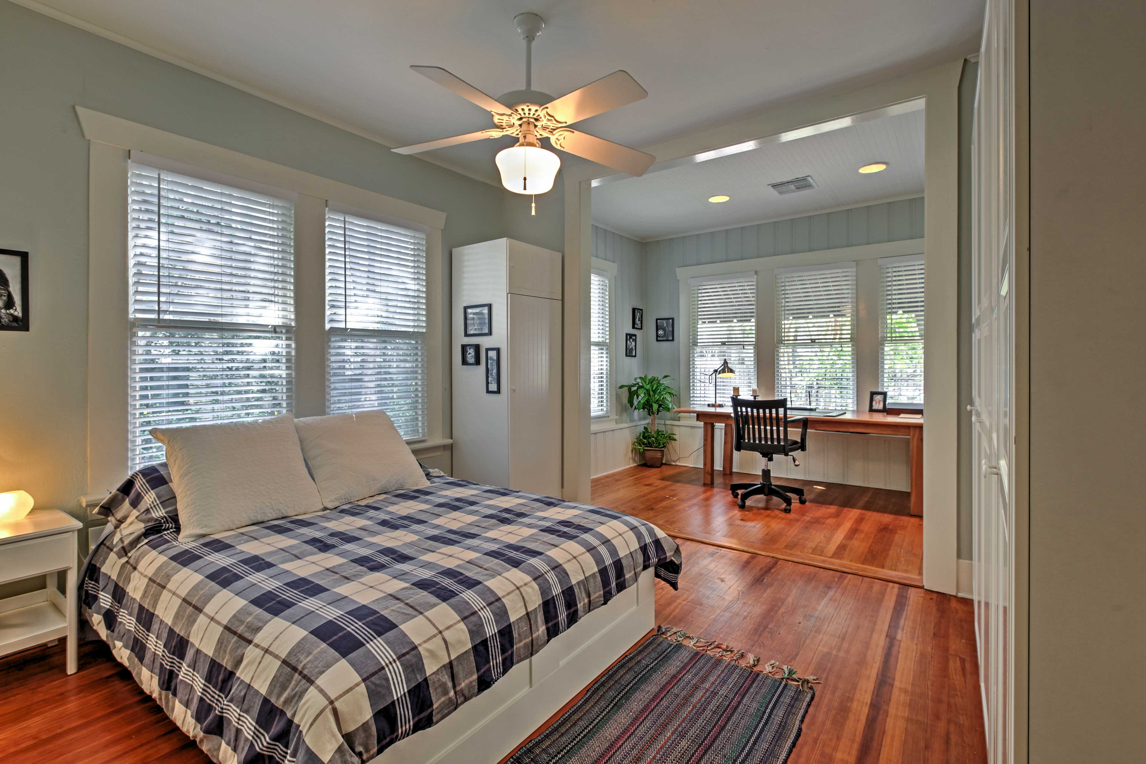 The Modern bedroom has bright windows throughout to illuminate the space.