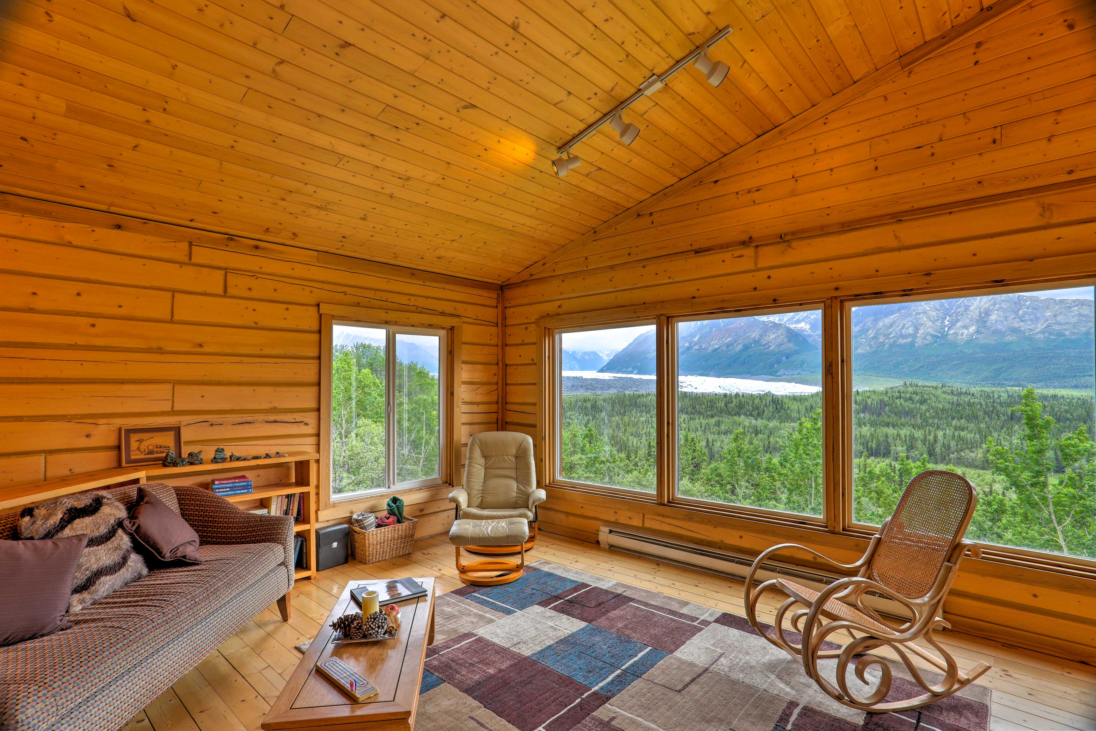 Mountain views and natural light fill the cathedral ceiling living space.