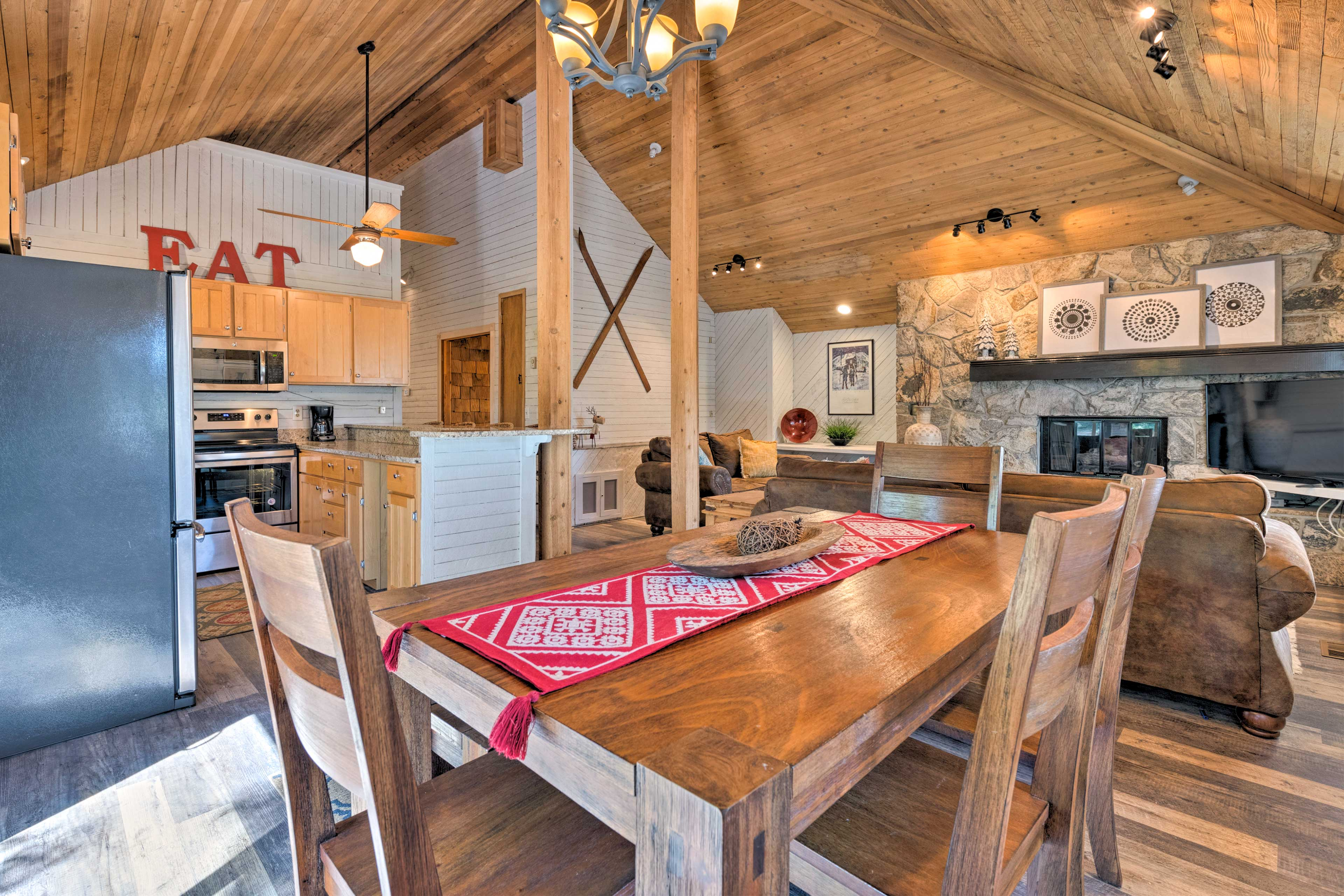 Admire the vaulted wood ceilings that soar above in the main living space.