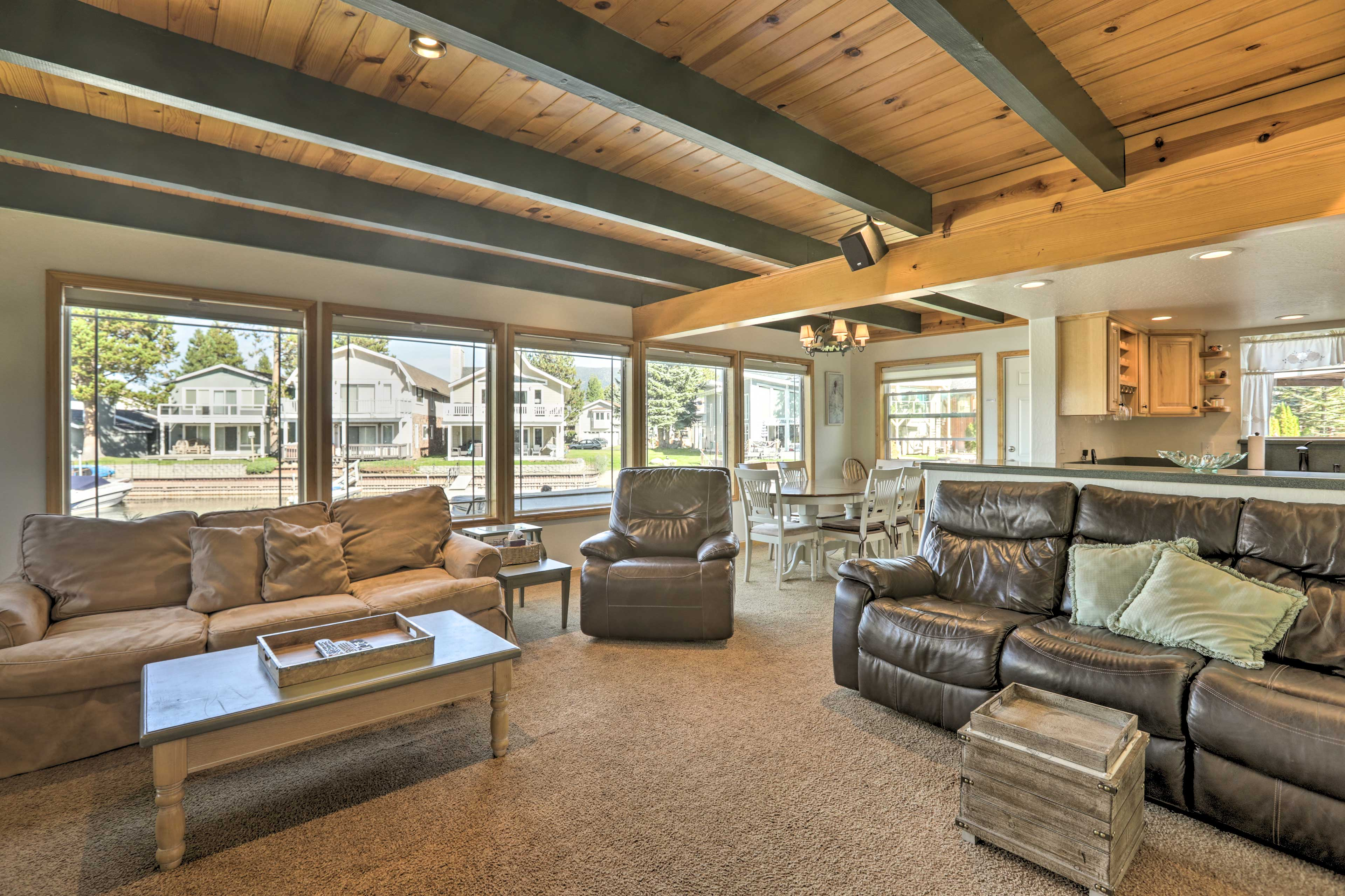 Natural light pours into this main living space through huge windows!