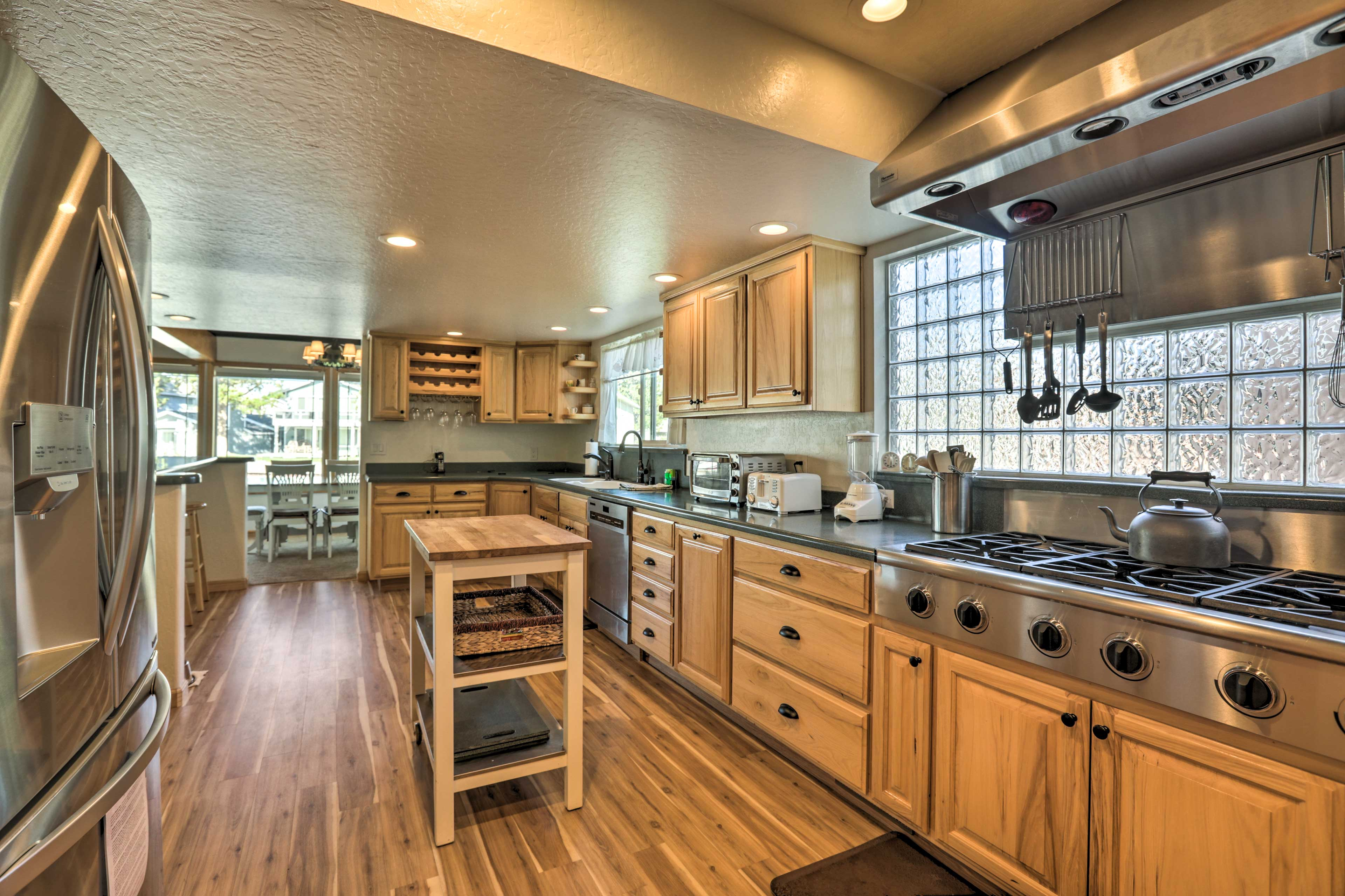 The fully equipped kitchen features top-of-the-line stainless steel appliances.