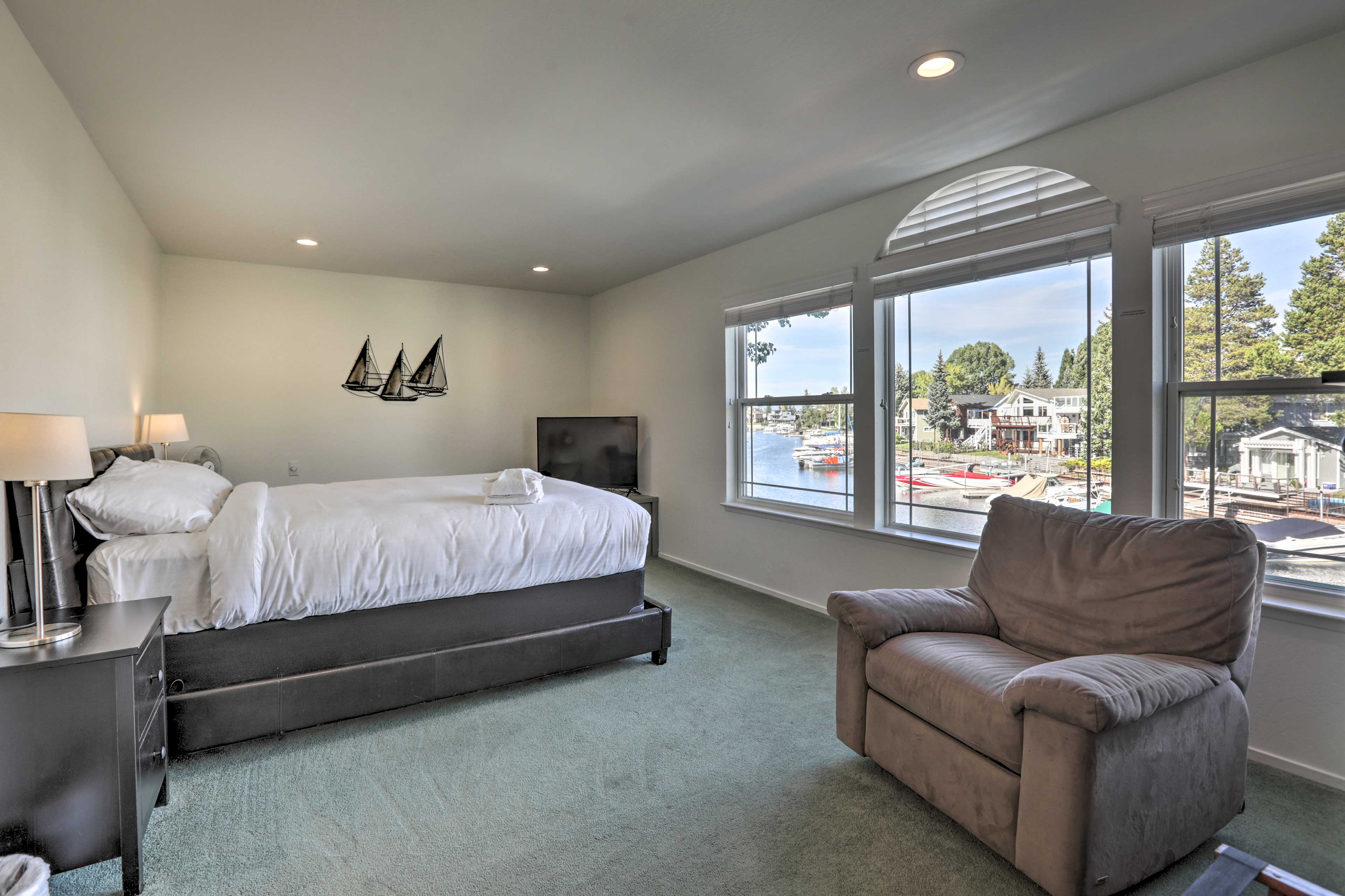 Retreat to the cozy master bedroom with flat screen TV.