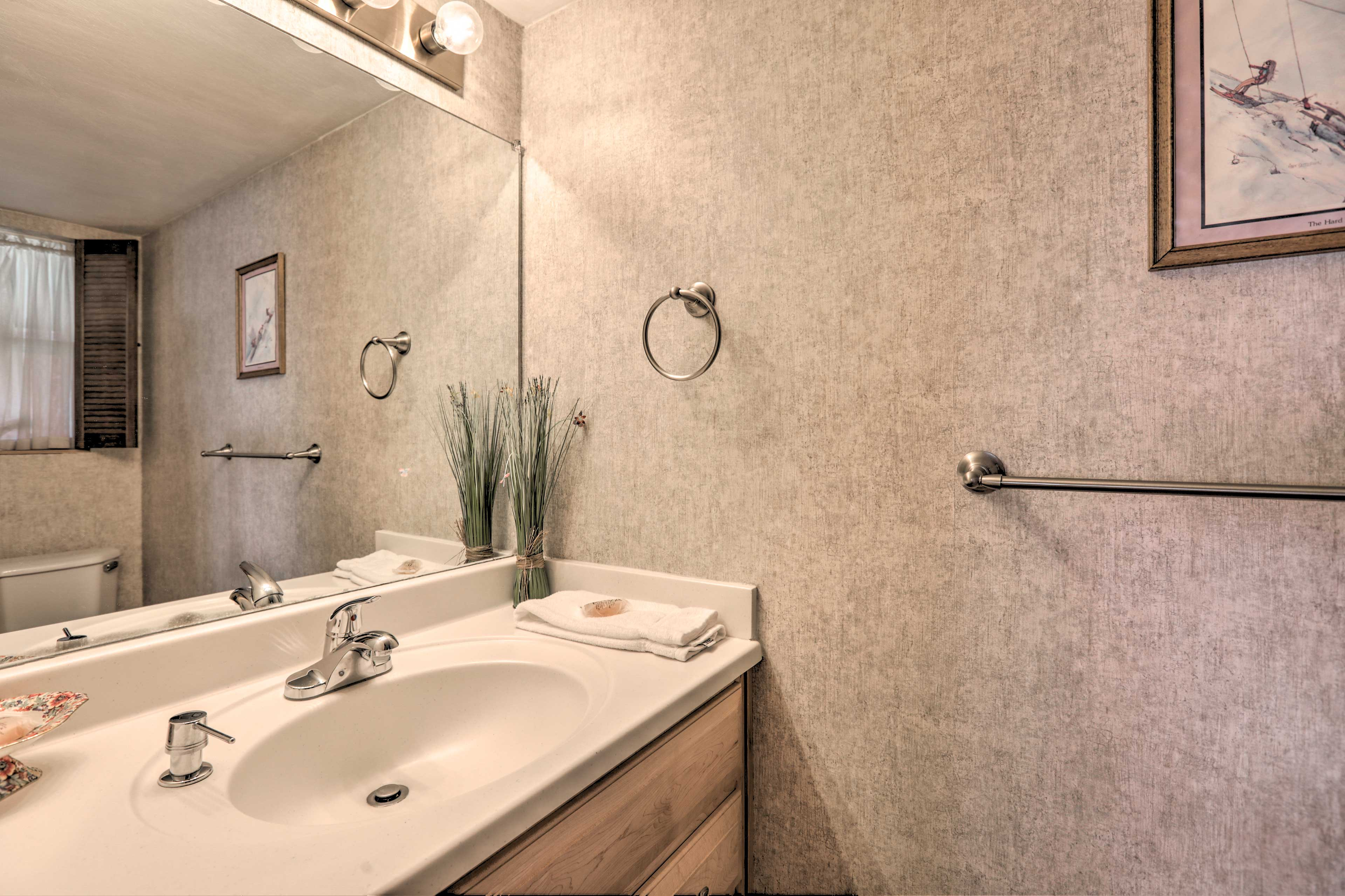 Freshen up in this bathroom before heading out to explore.