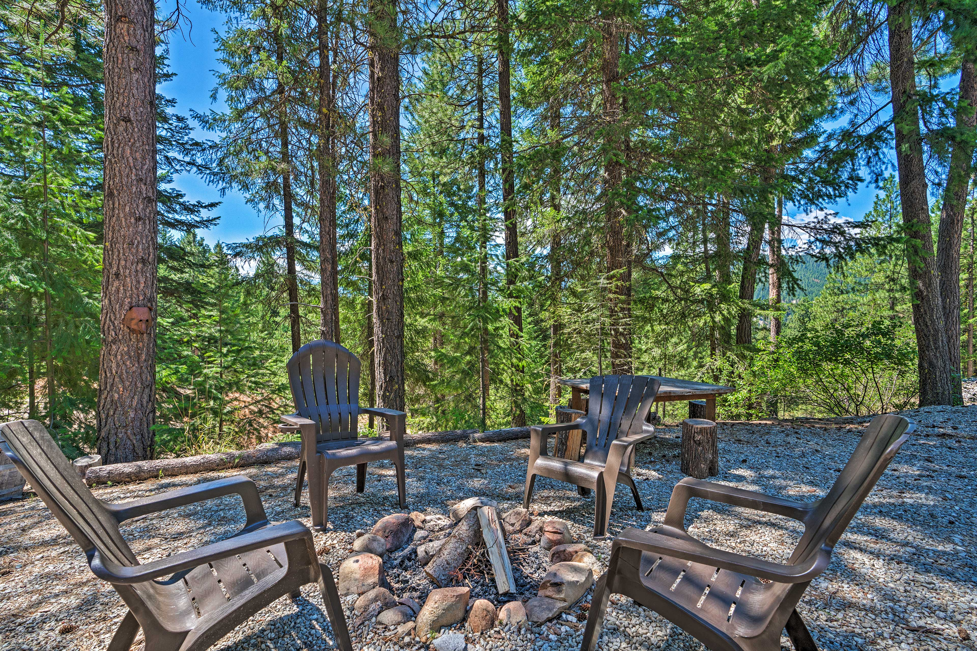 The property features an abundance of outdoor amenities, including a fire pit.