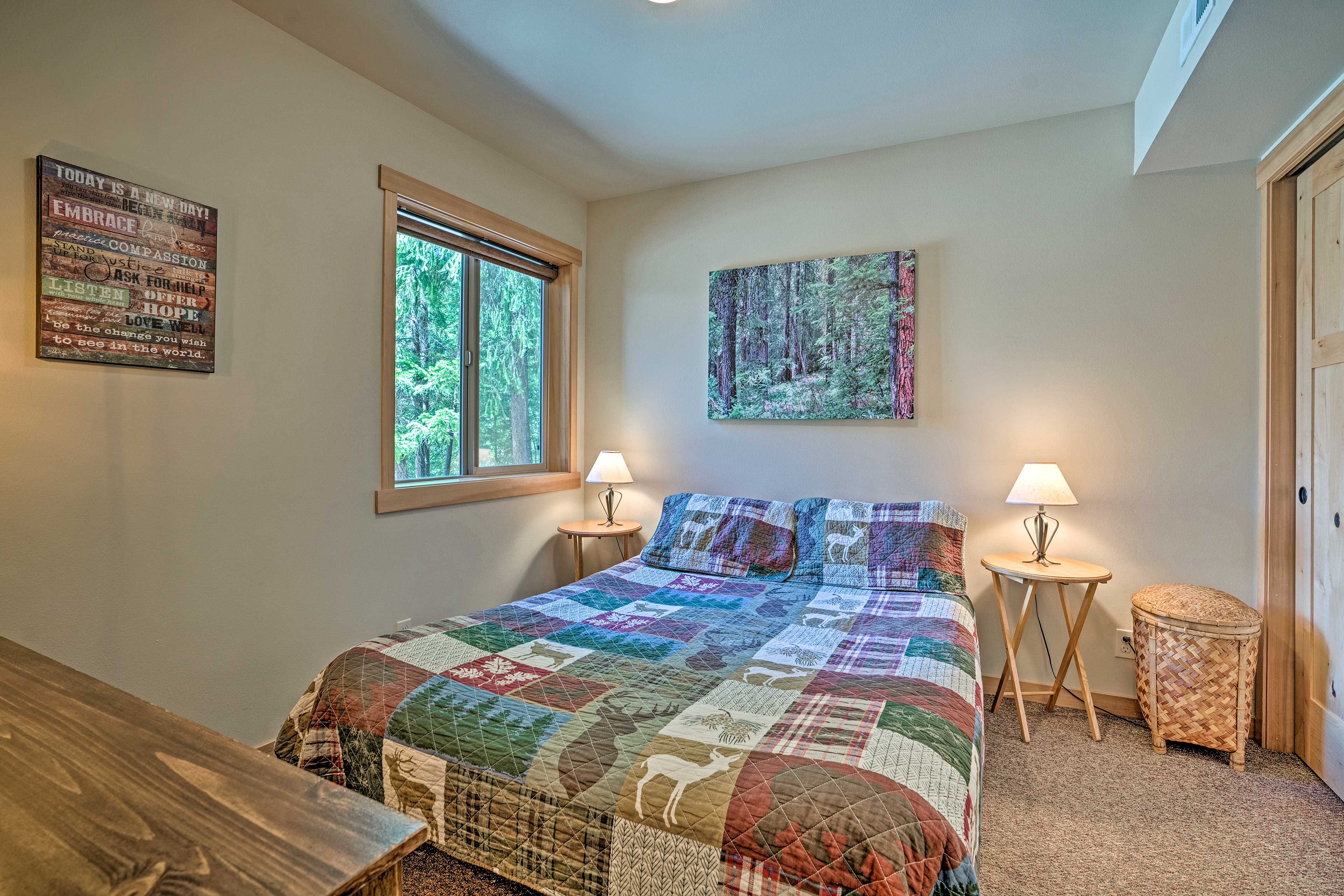 The bedroom has a queen bed.