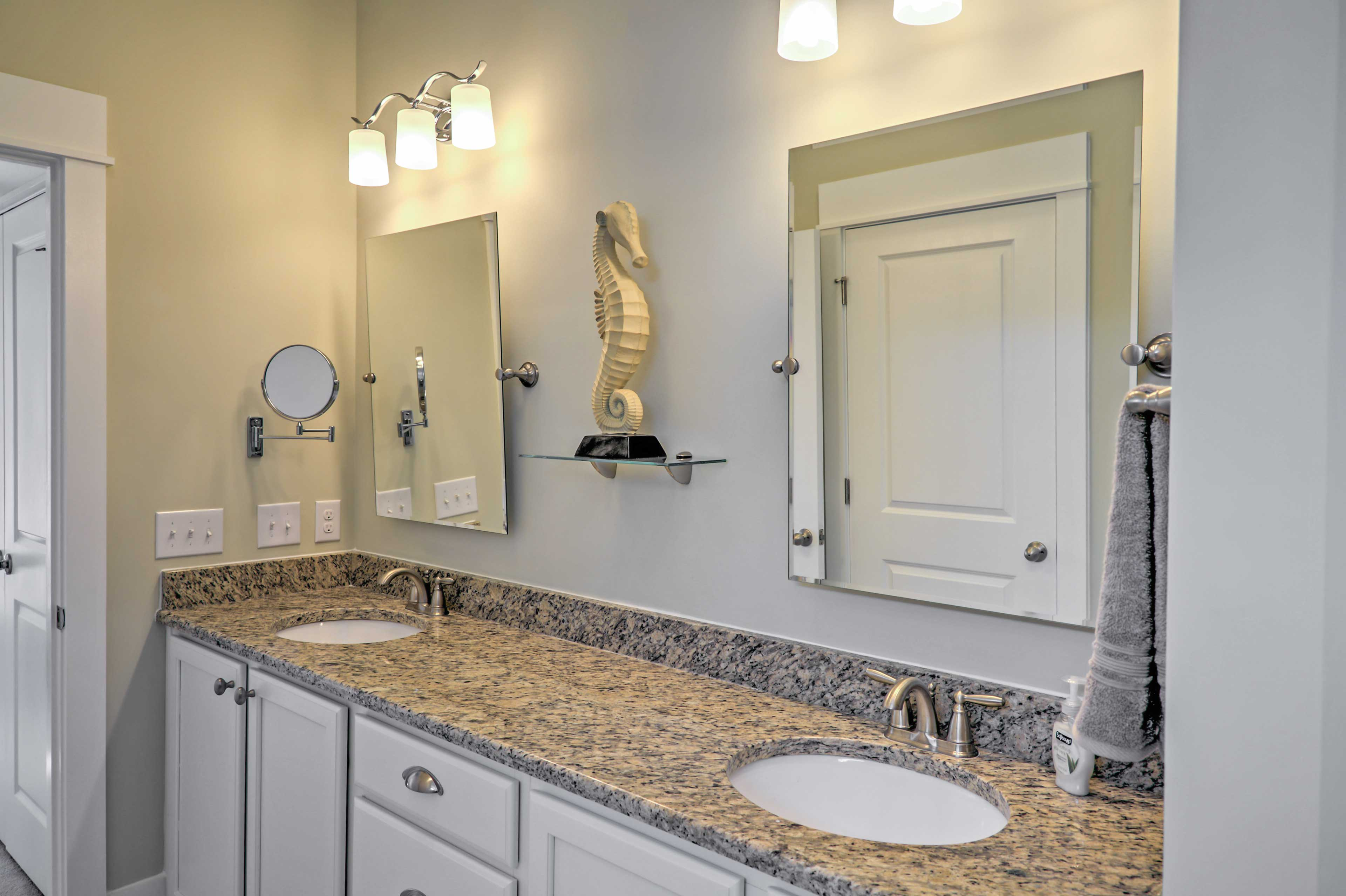 There's plenty of counter space for many to get ready in the master bathroom!