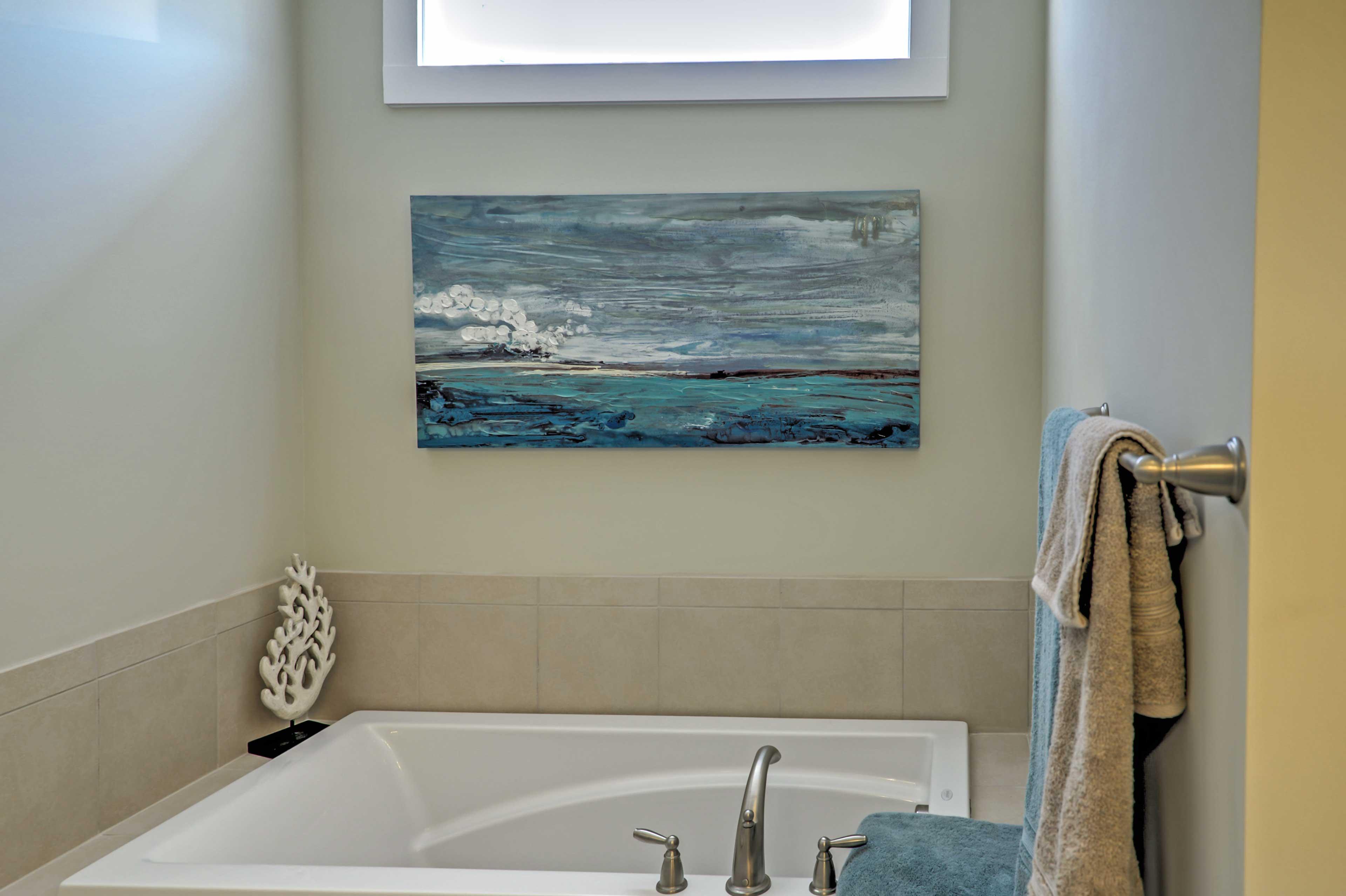 Enjoy a soothing bubble bath in the master bathroom.