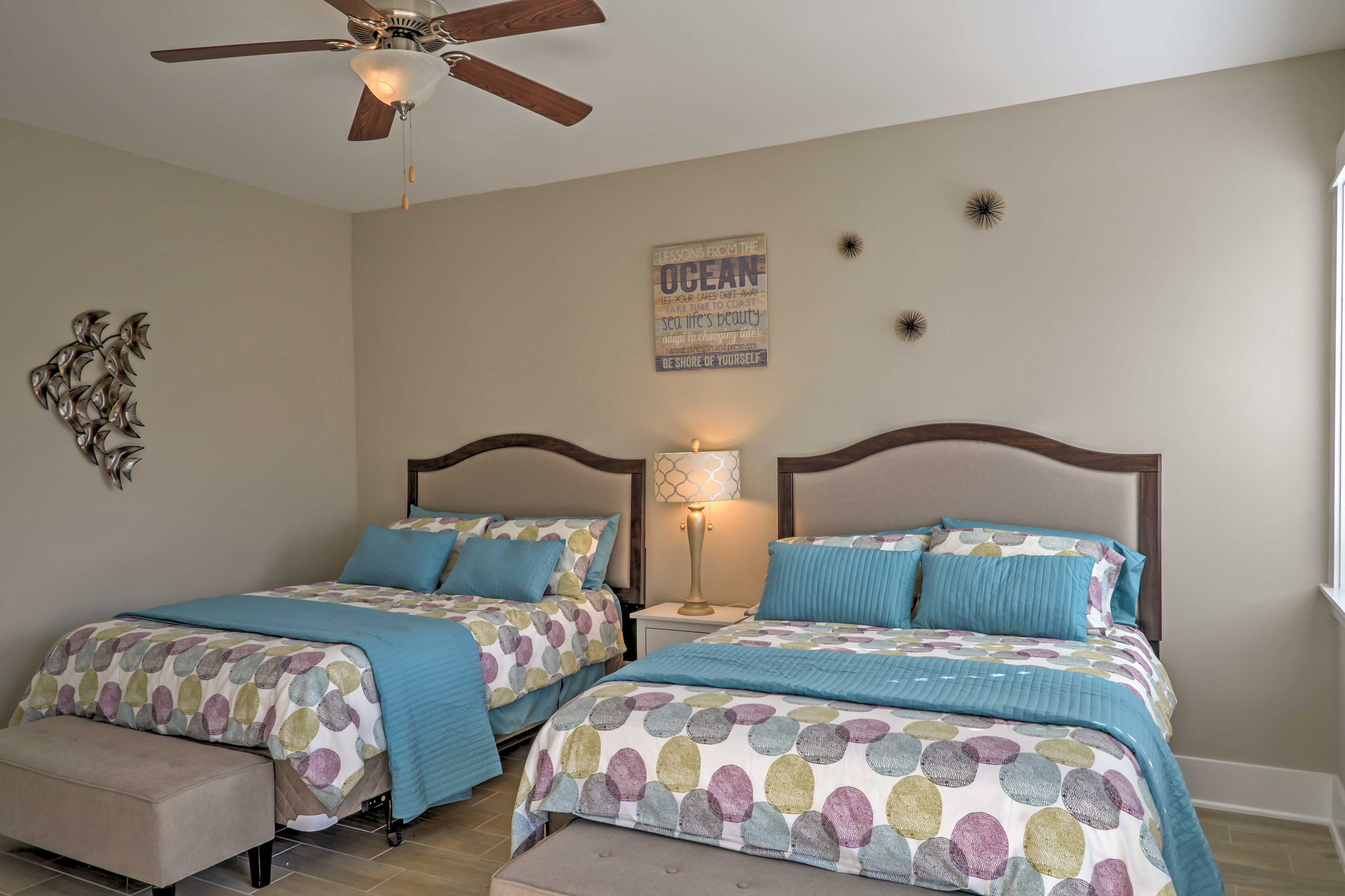 Sweet dreams of a beachy paradise await you in these queen-sized beds!