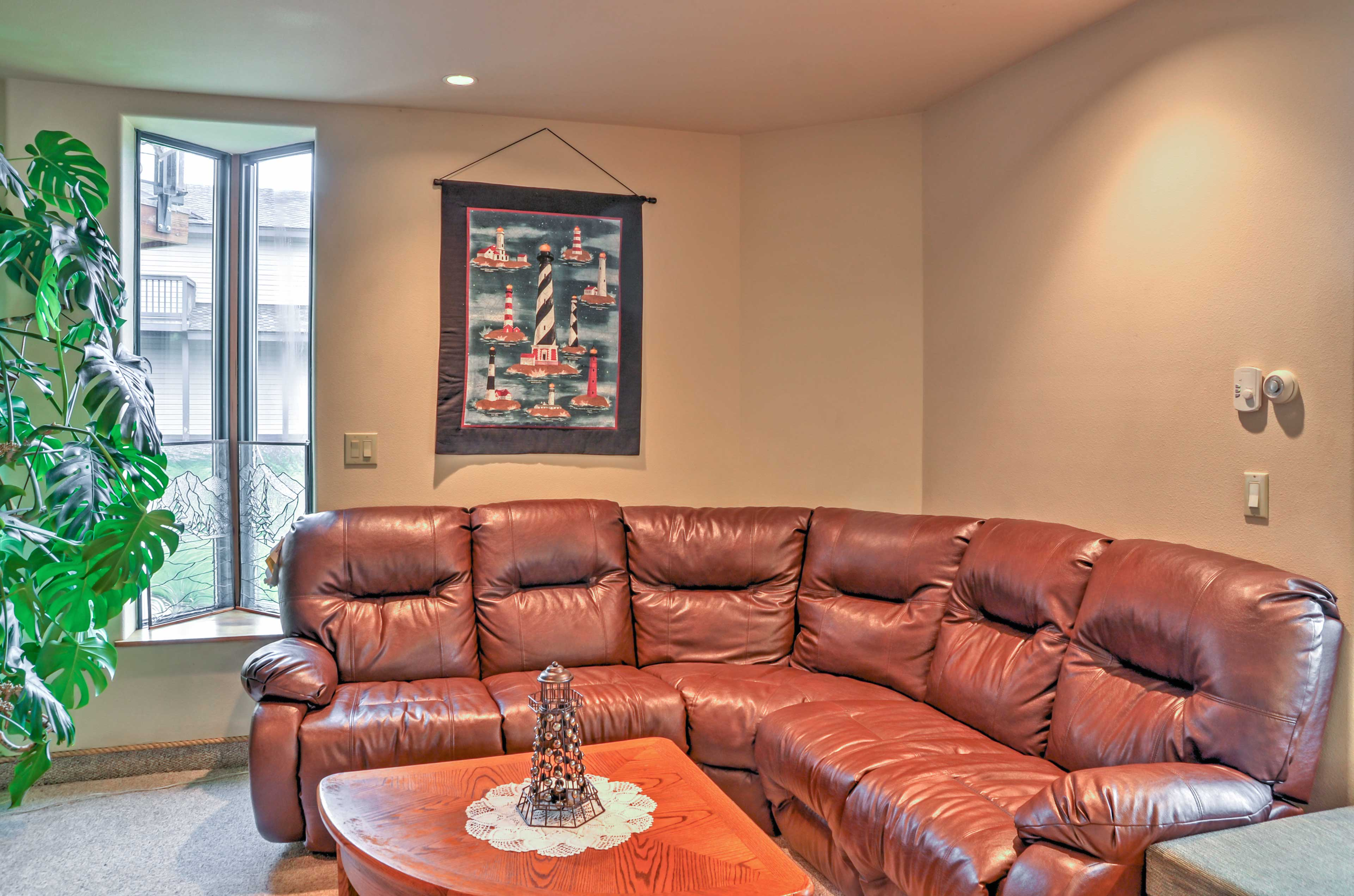 Kick back with your loved ones on the giant leather sofa!