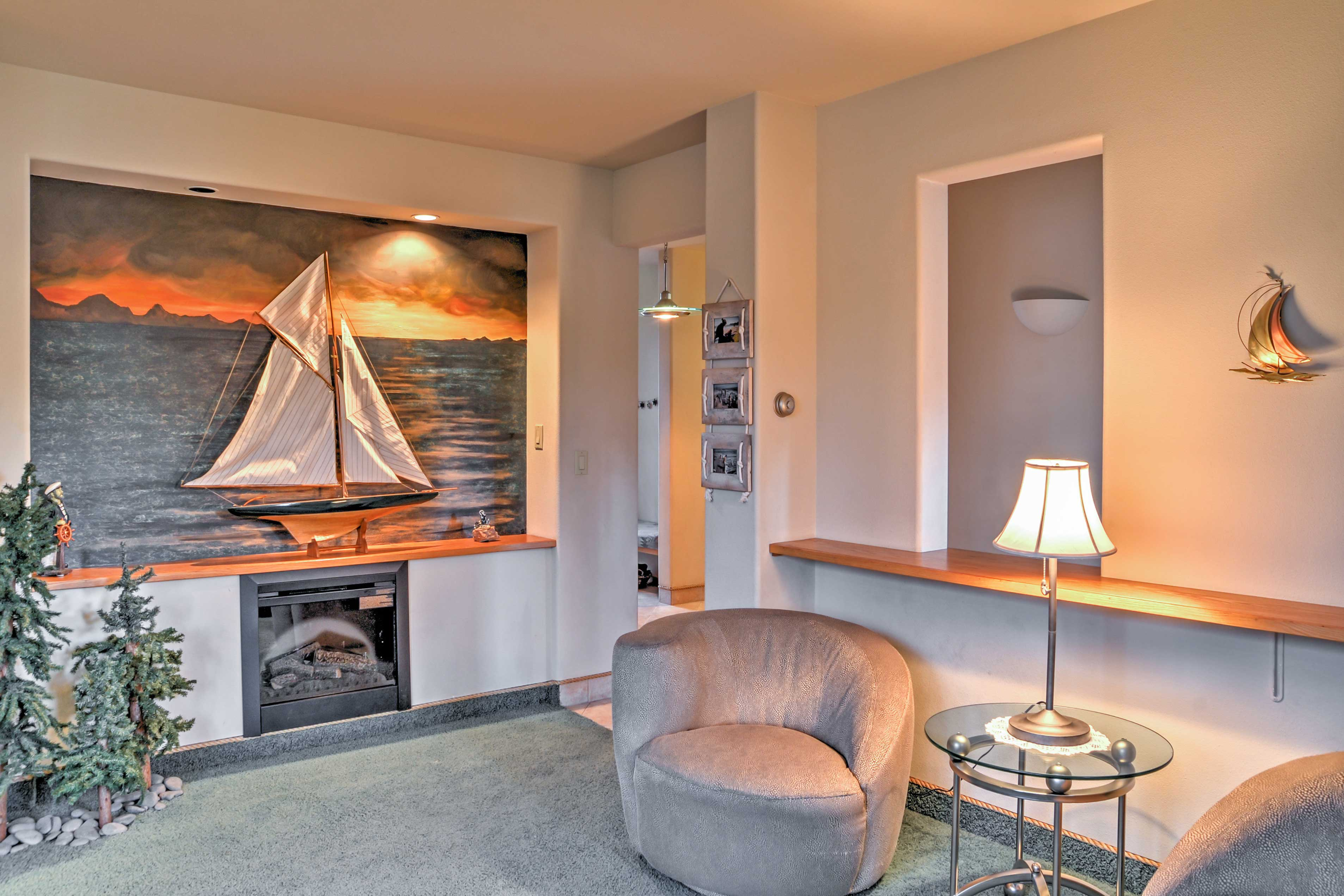 Relax by the warmth of the electric fireplace in this cozy living area.