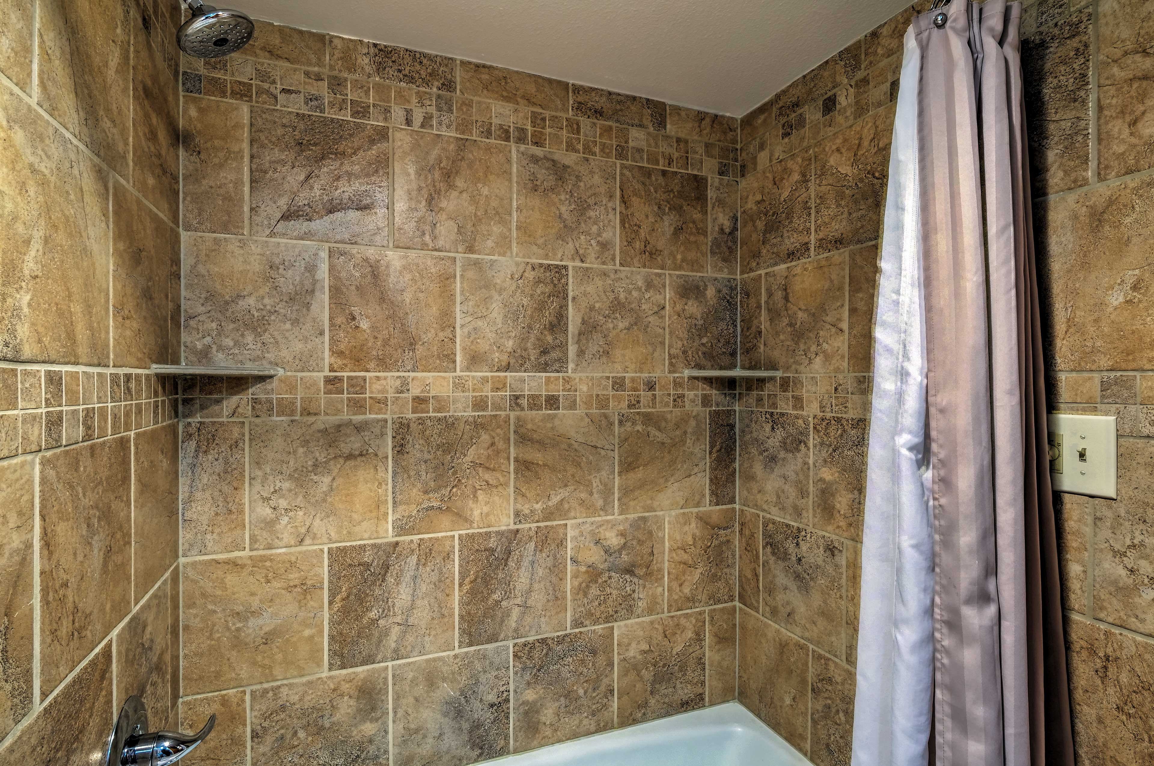 The bathroom is complete with a shower/tub combo.