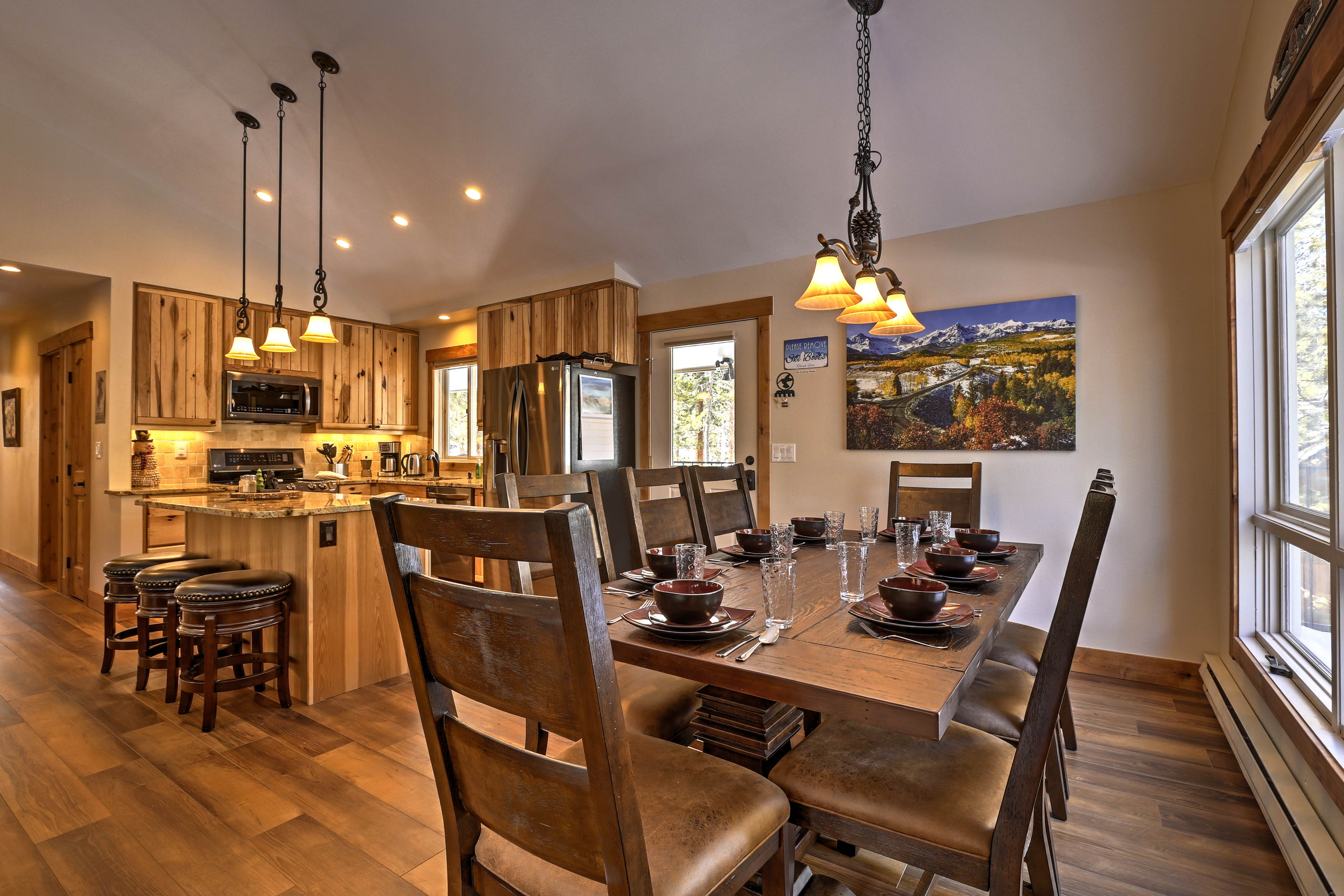 The large dining table can accommodate your group as you enjoy a delicious meal.