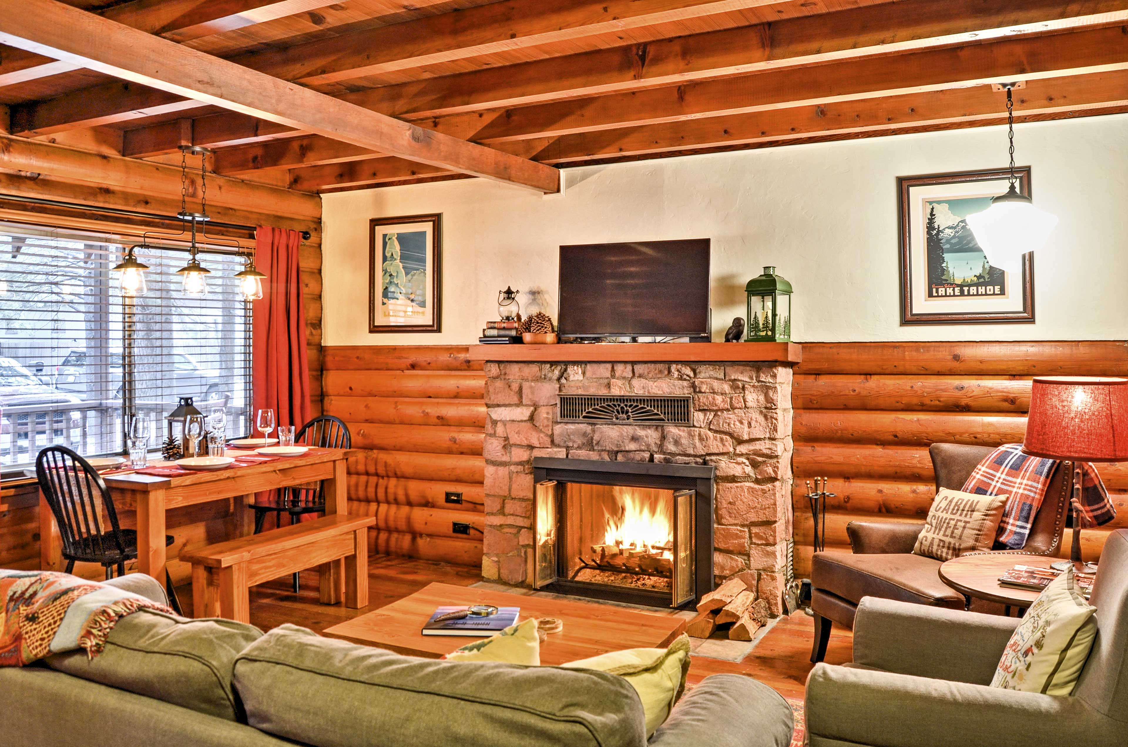 Cuddle around the cozy fireplace while watching the flat-screen Smart TV.