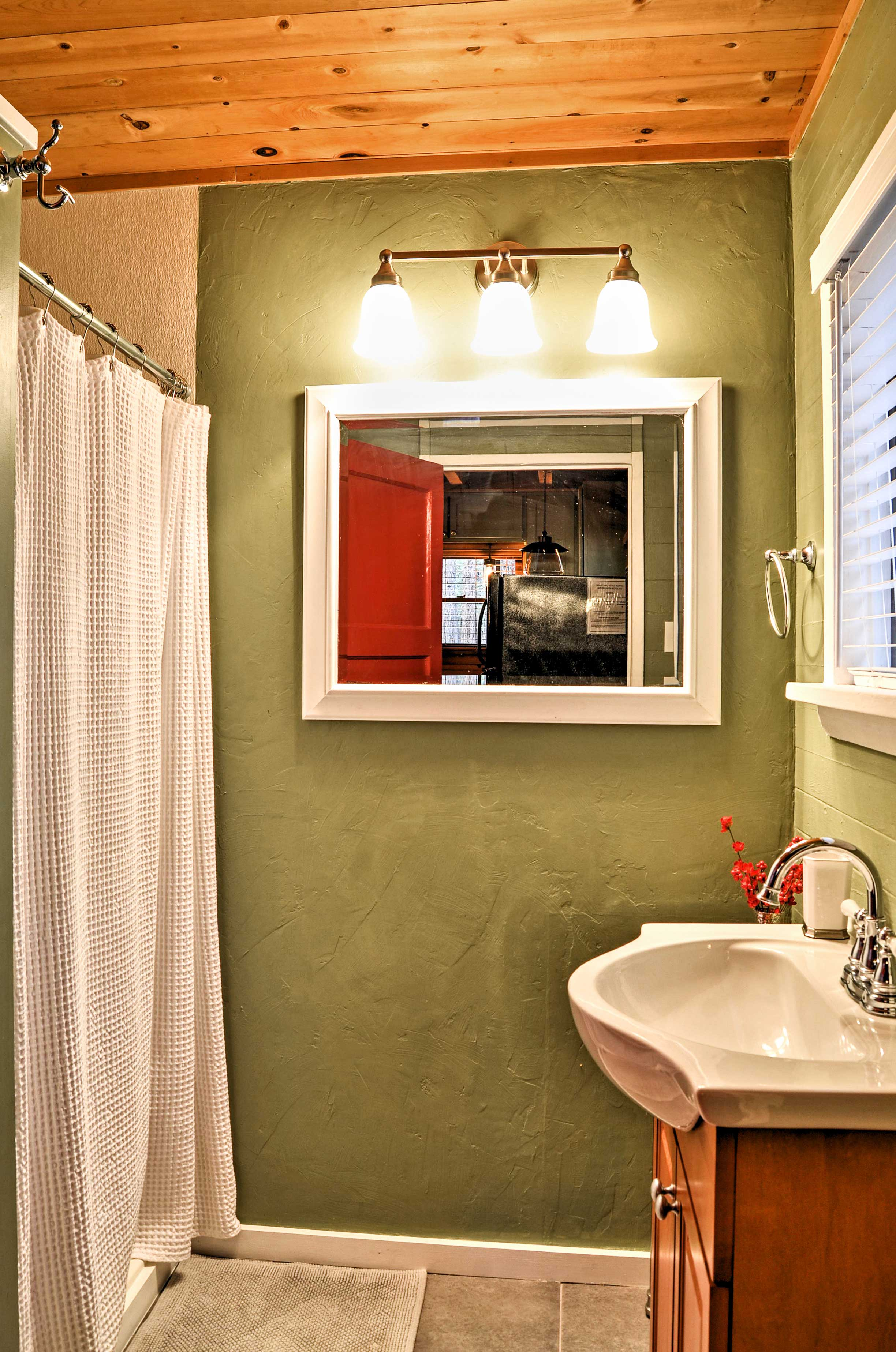 The bathroom hosts a walk-in shower.
