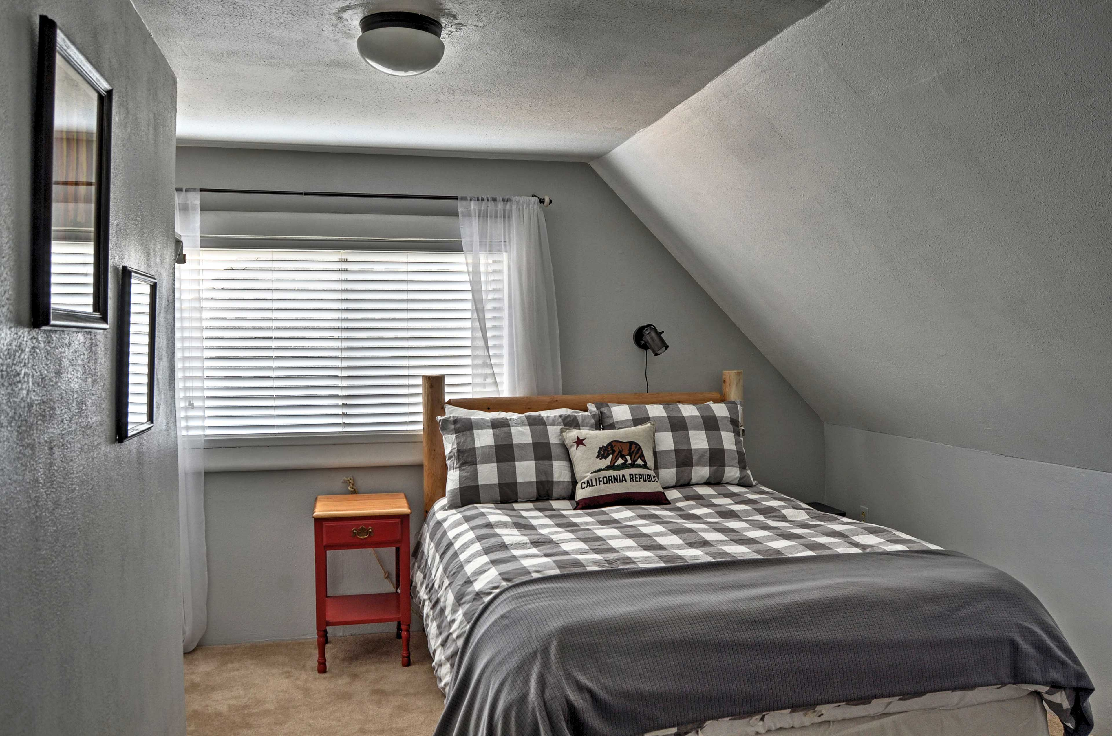 The master bedroom hosts a queen bed.