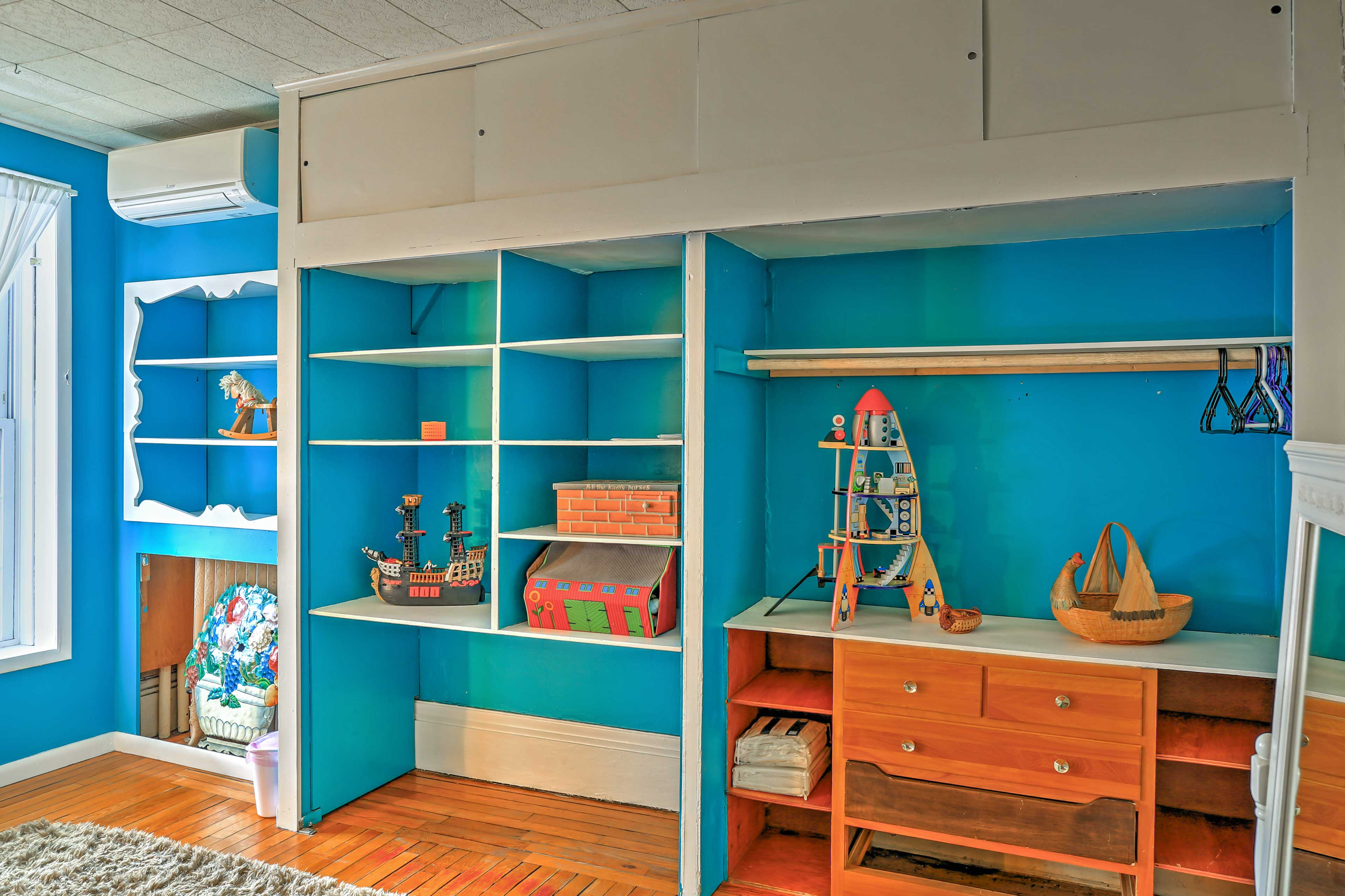 This room is brightened by vibrant blue walls!
