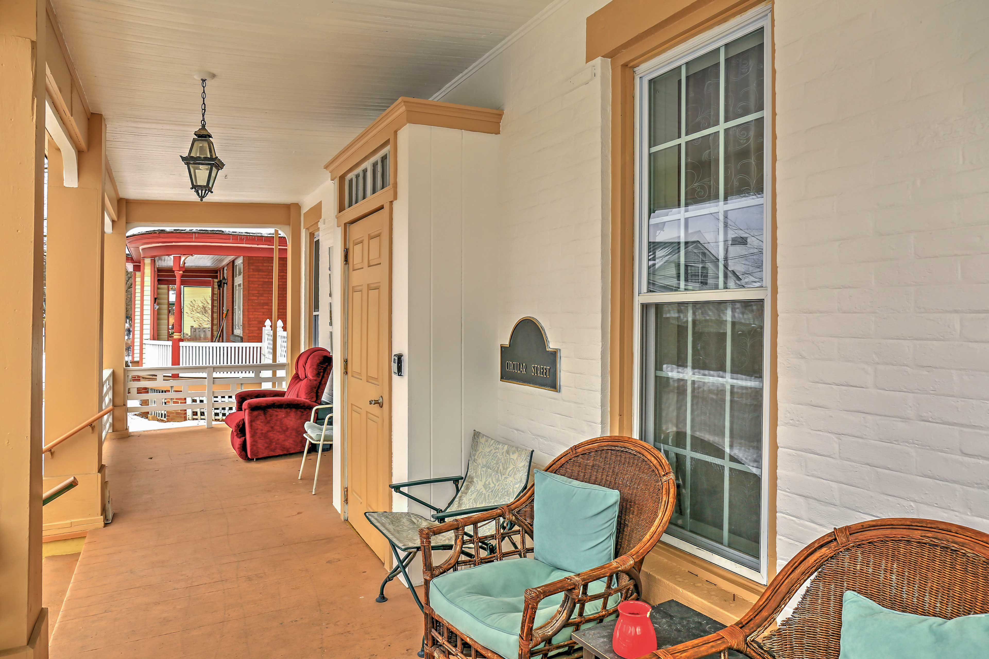 The front porch is the ideal place to sip a glass of wine.