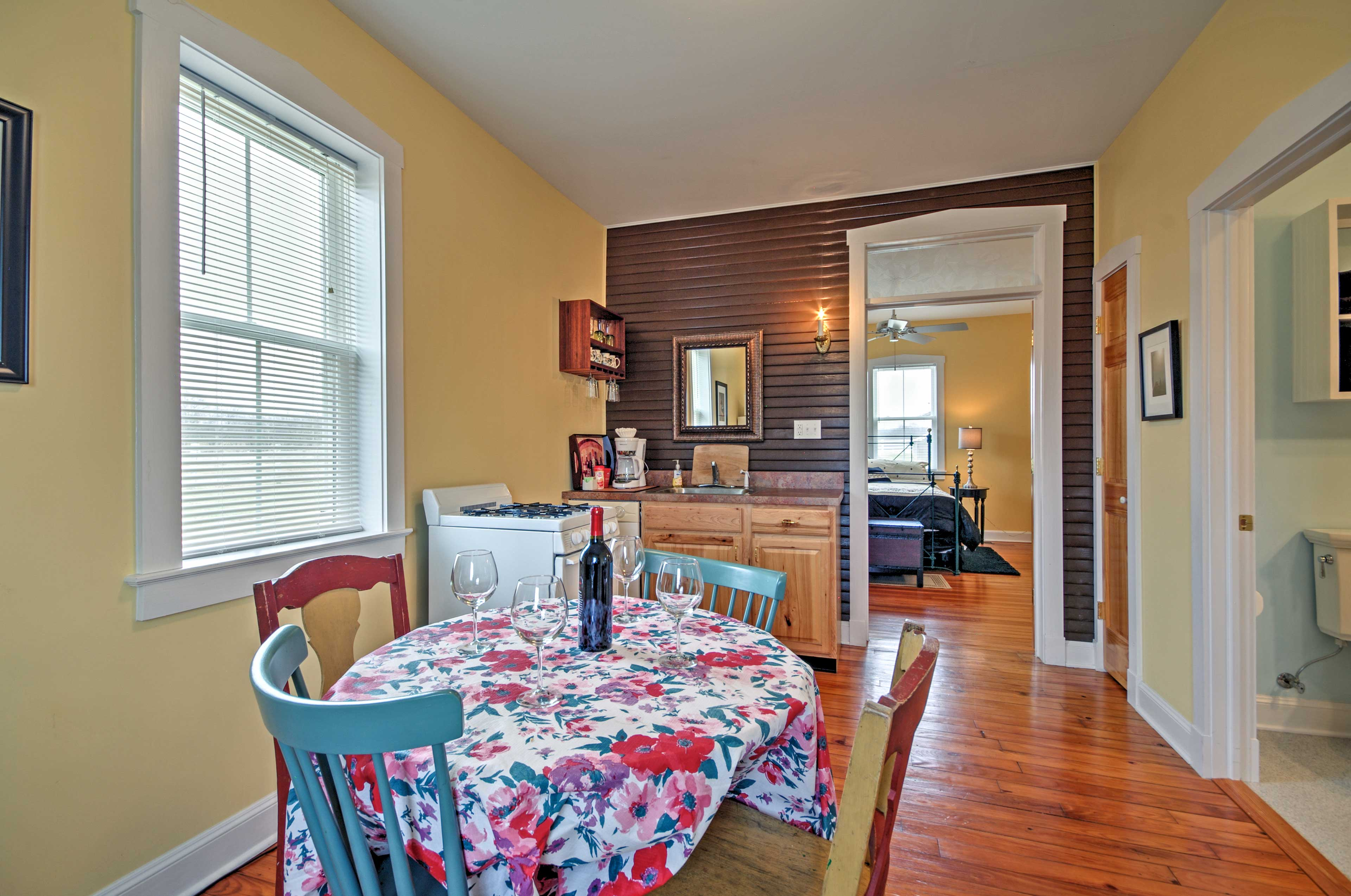 The living space features gleaming hardwood floors.