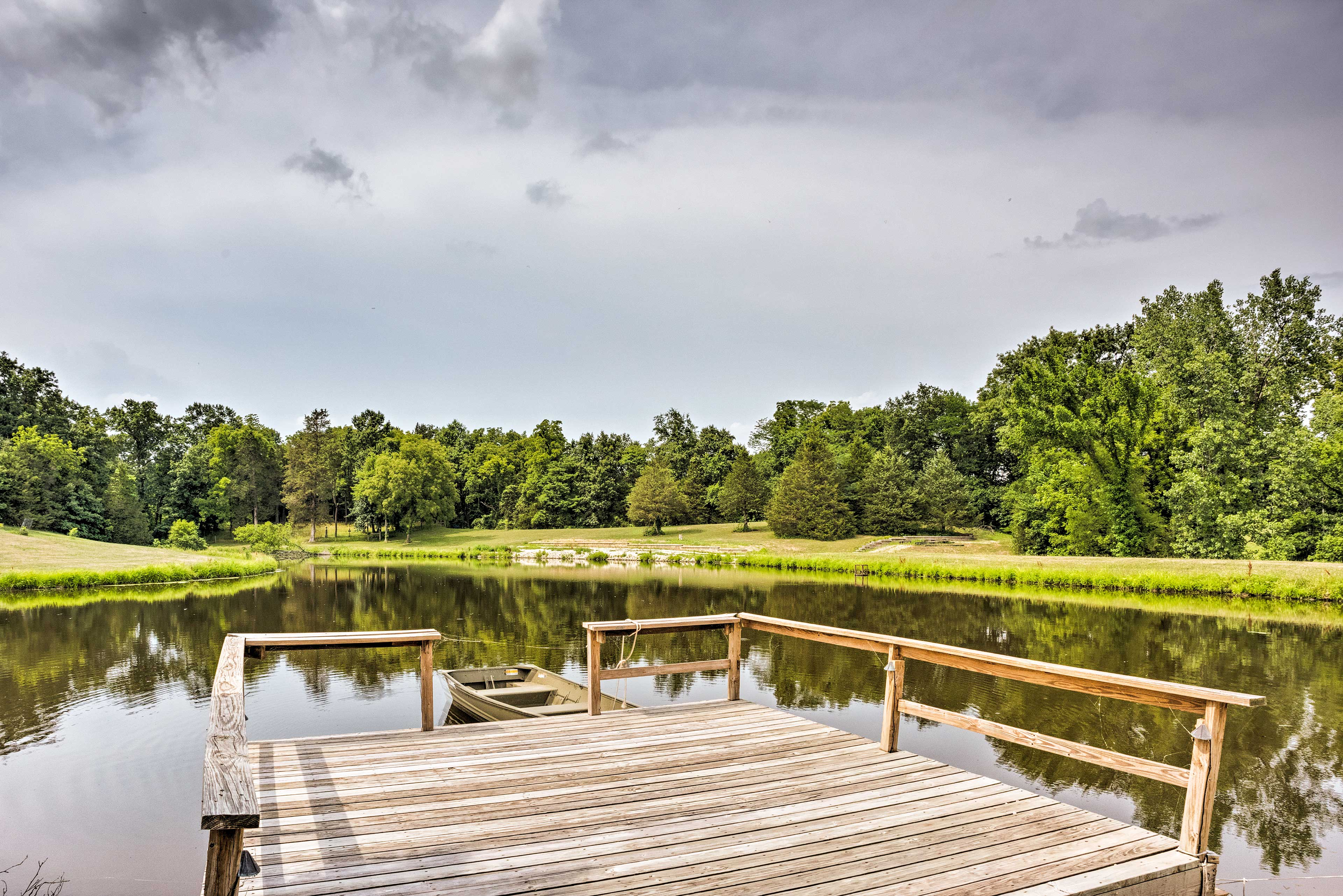 The abode is set on a working farm with a pond and pool.