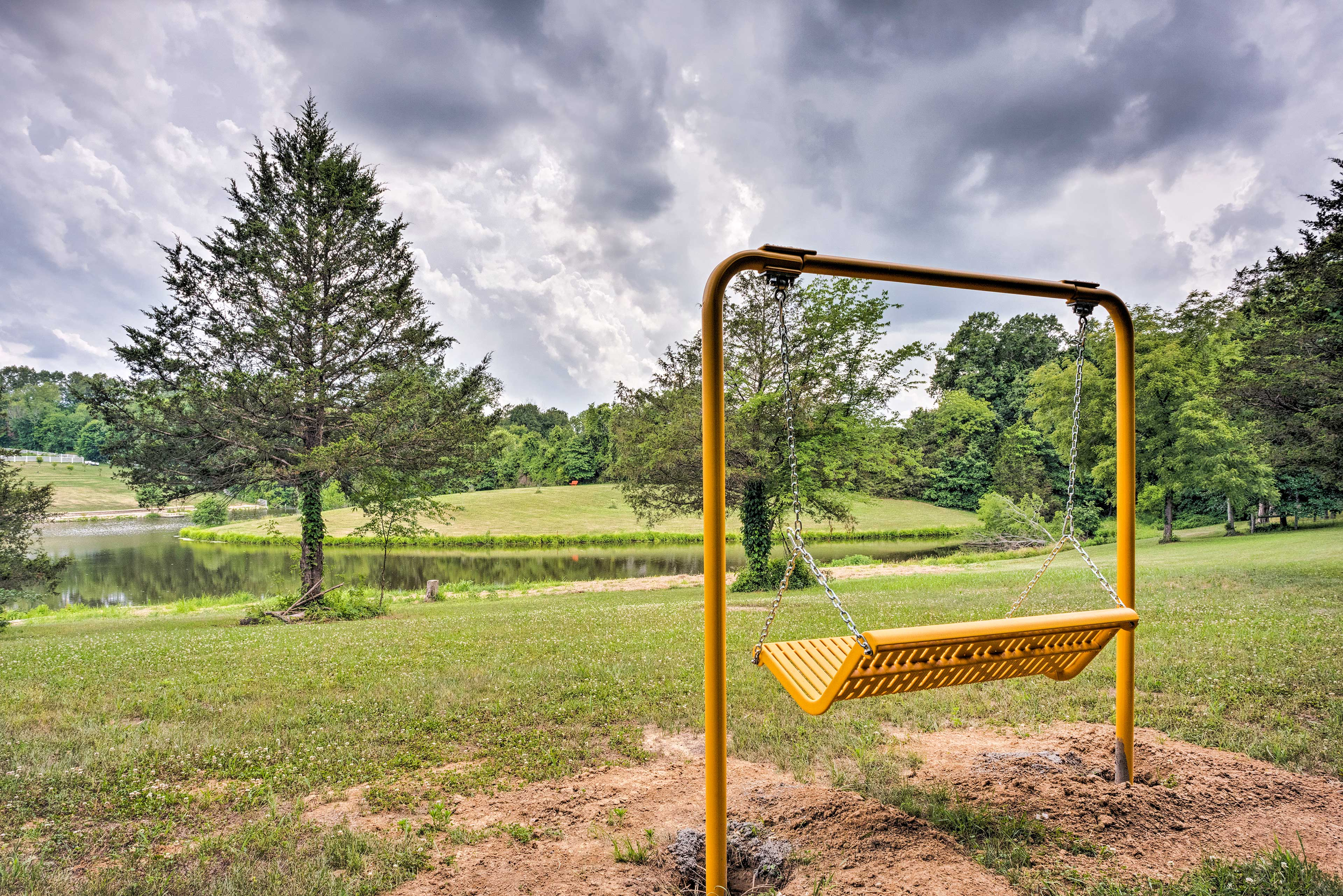 This swing offers unforgettable views of the pond.