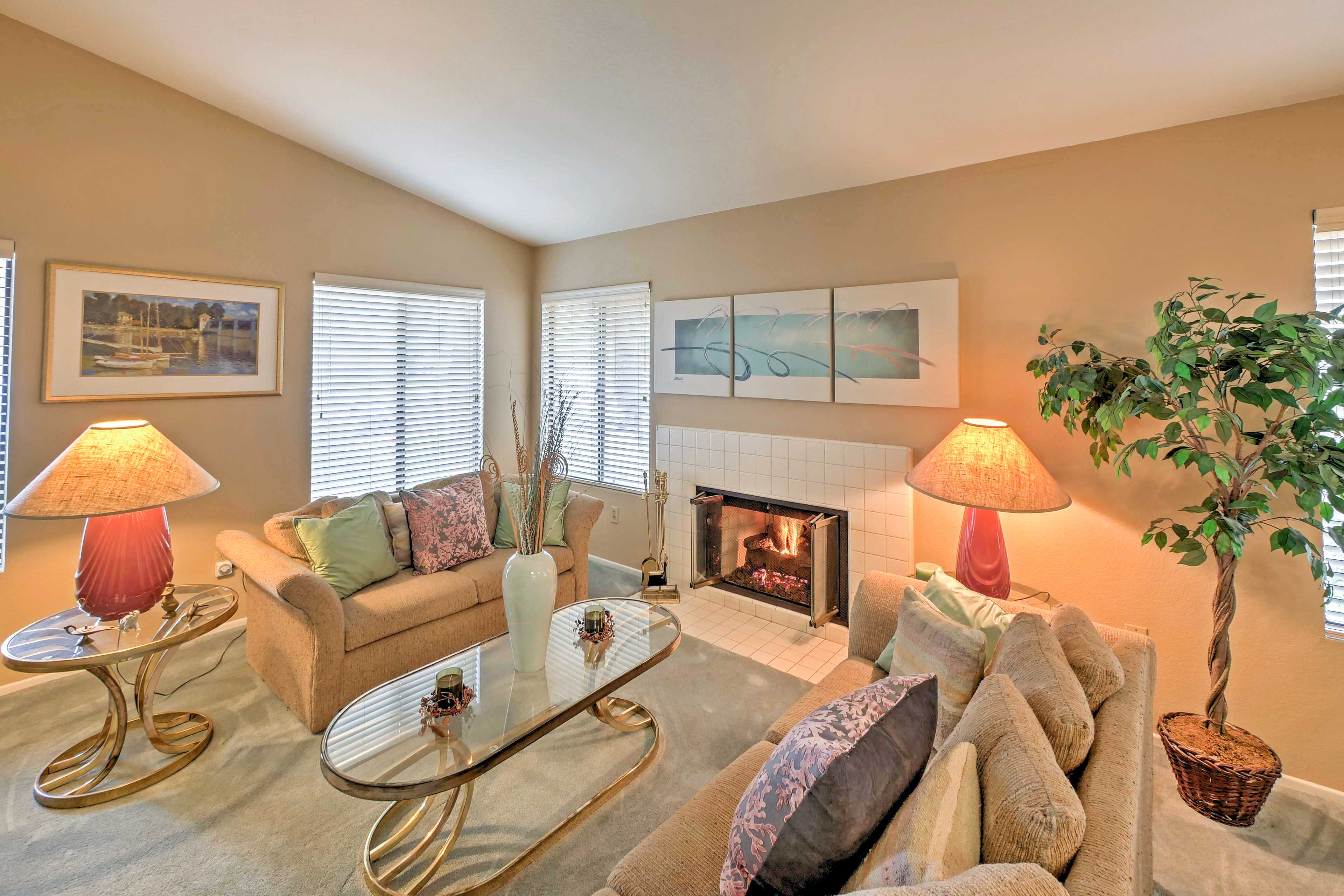 Cozy up next the gas fireplace in the spacious living room area.