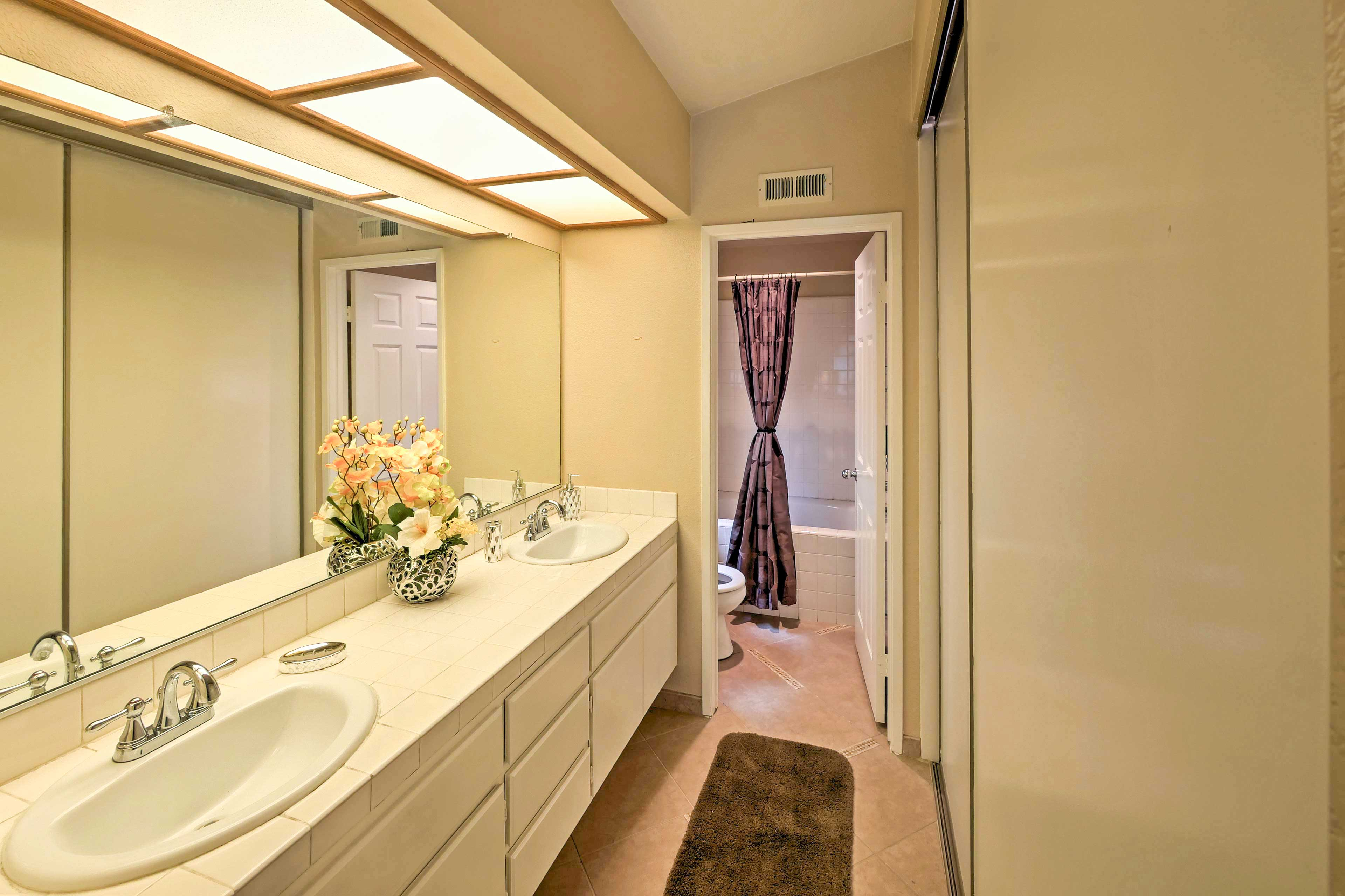 Rinse away your daily activities in the tidy master bathroom.