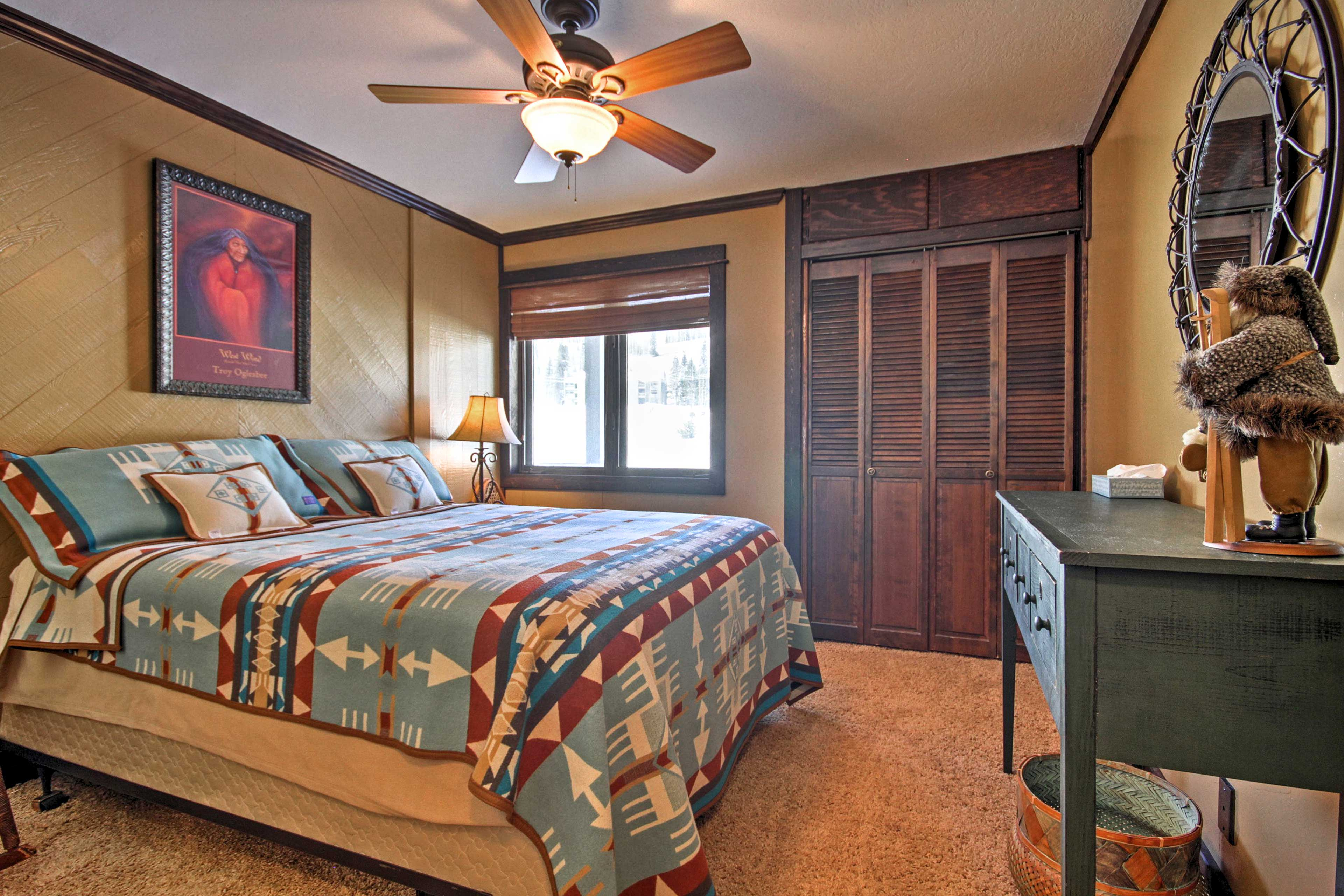 The beds feature Pendleton bedding and feather pillows.