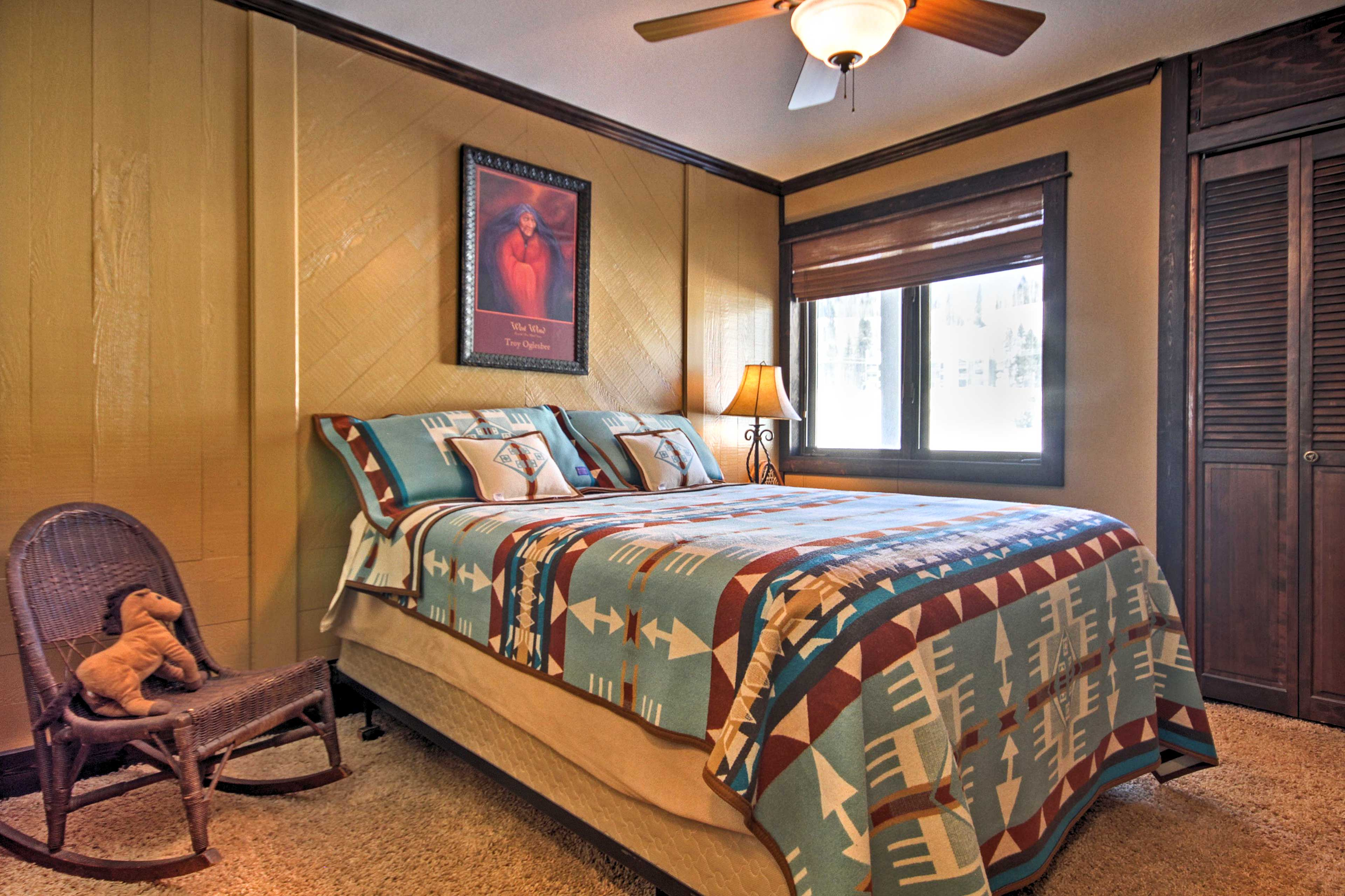 Rest easy on the queen bed in this bedroom.