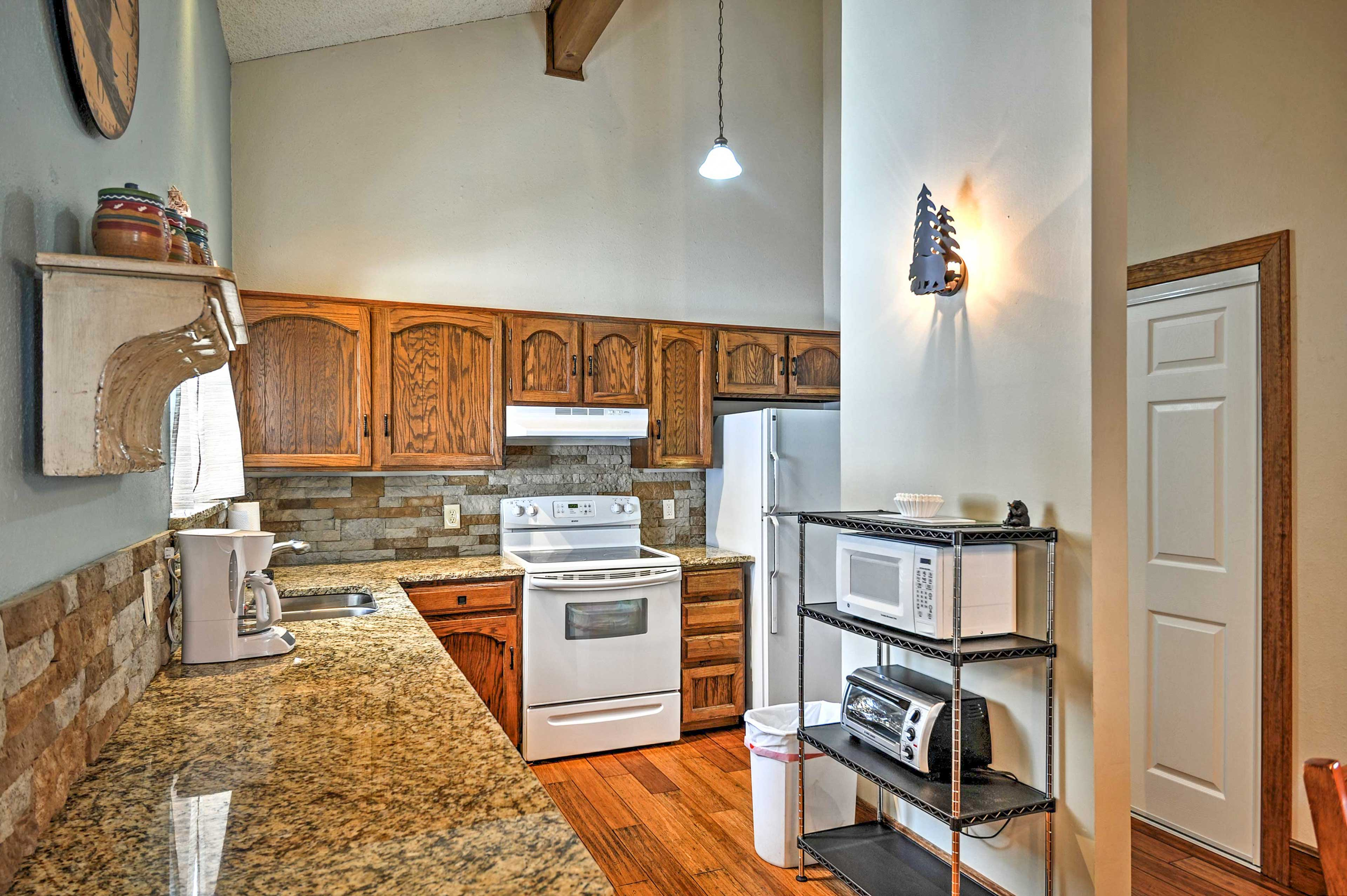 The kitchen features granite counters.