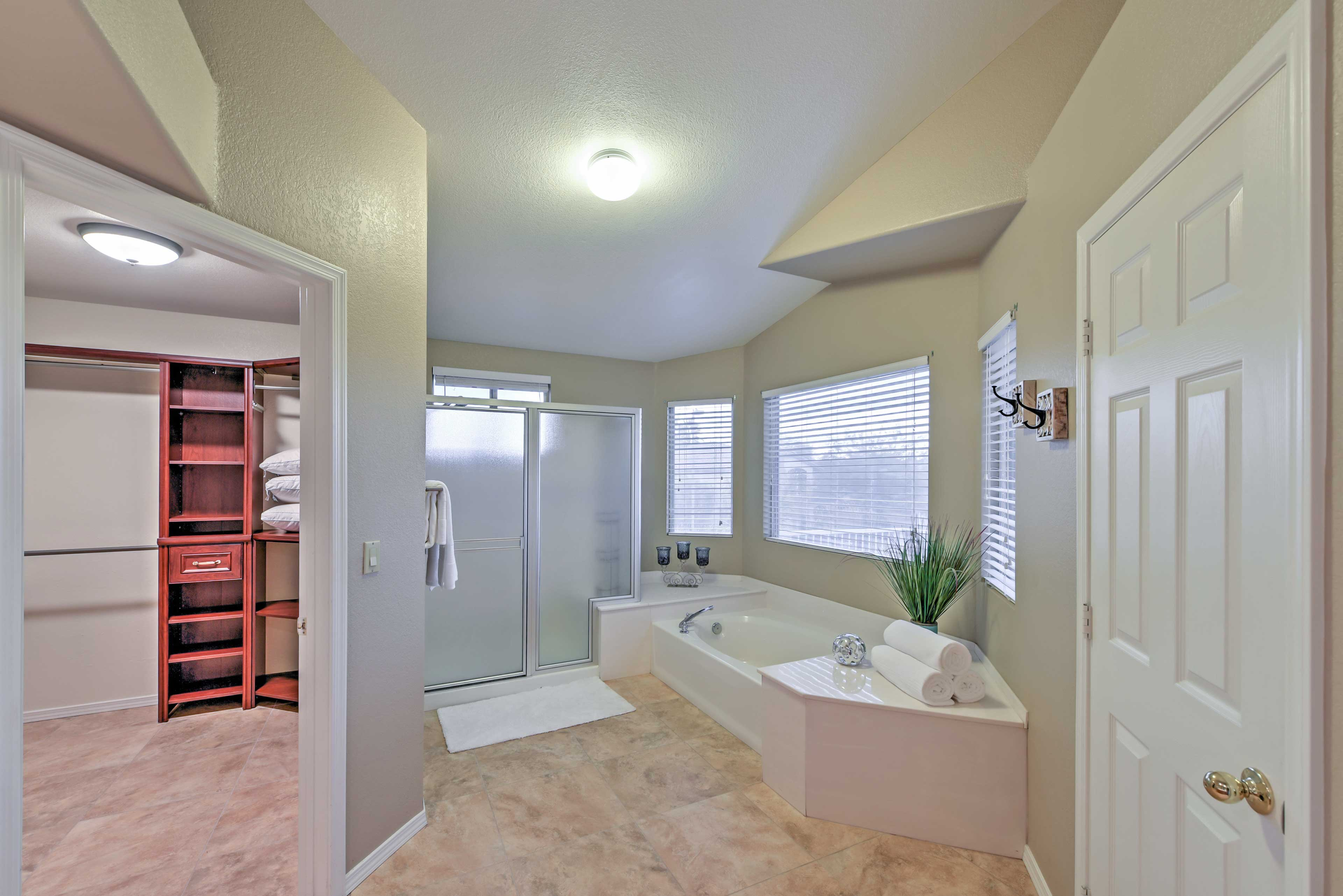 Soak in the jetted Jacuzzi tub and hang your clothes in the walk-in closet.