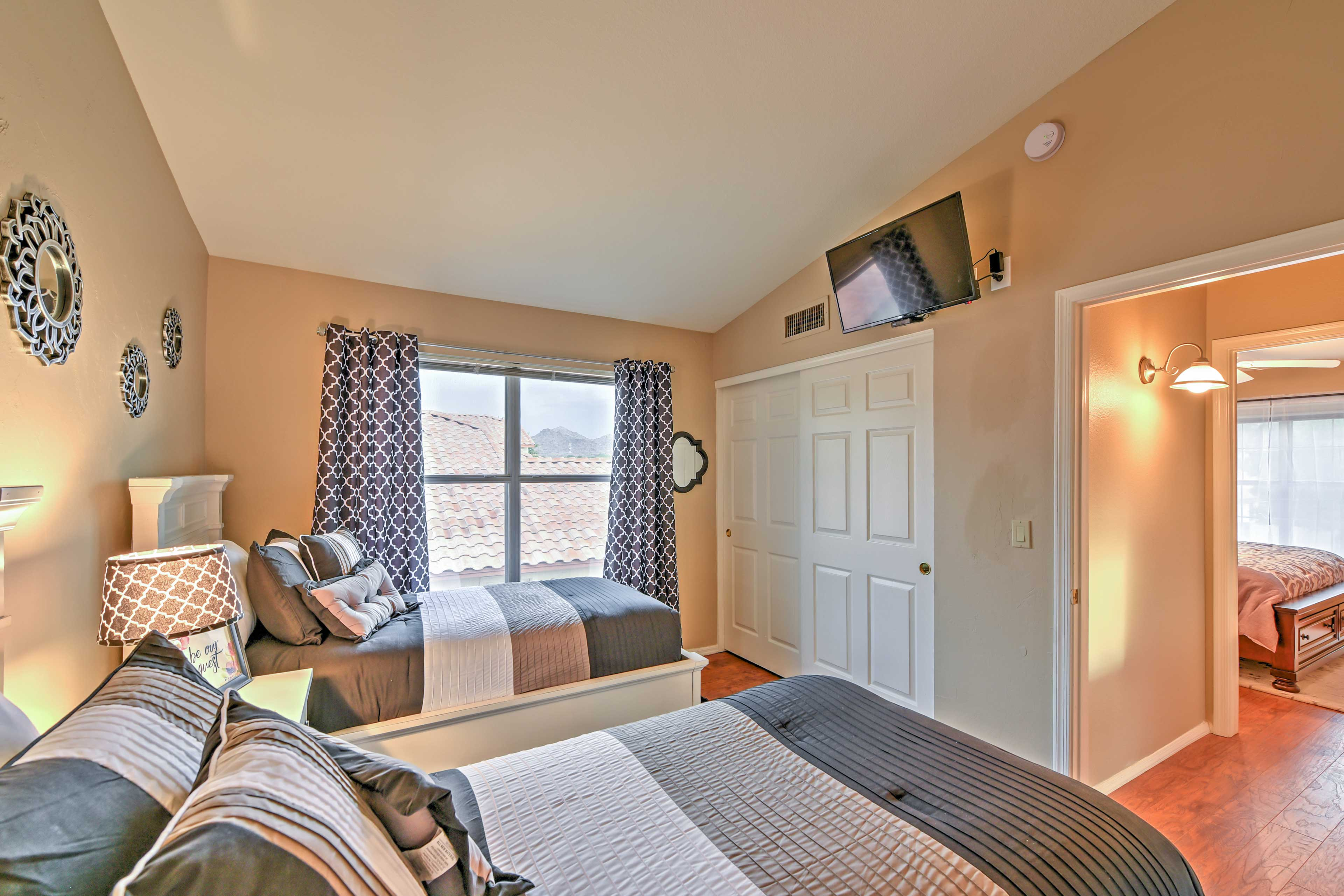 Unwind with a movie on the flat-screen TV from the 2 twin beds.