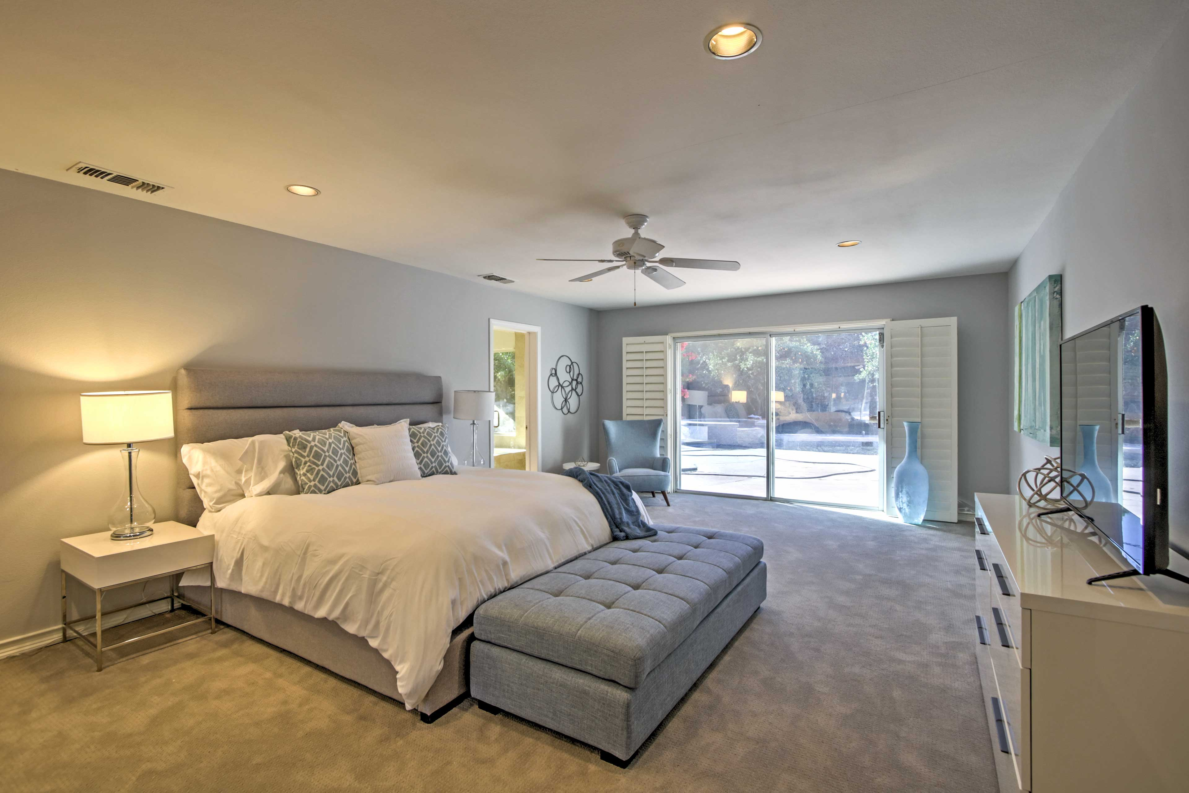 Each bedroom has a king-sized bed, en-suite bath, and flat-screen TV.