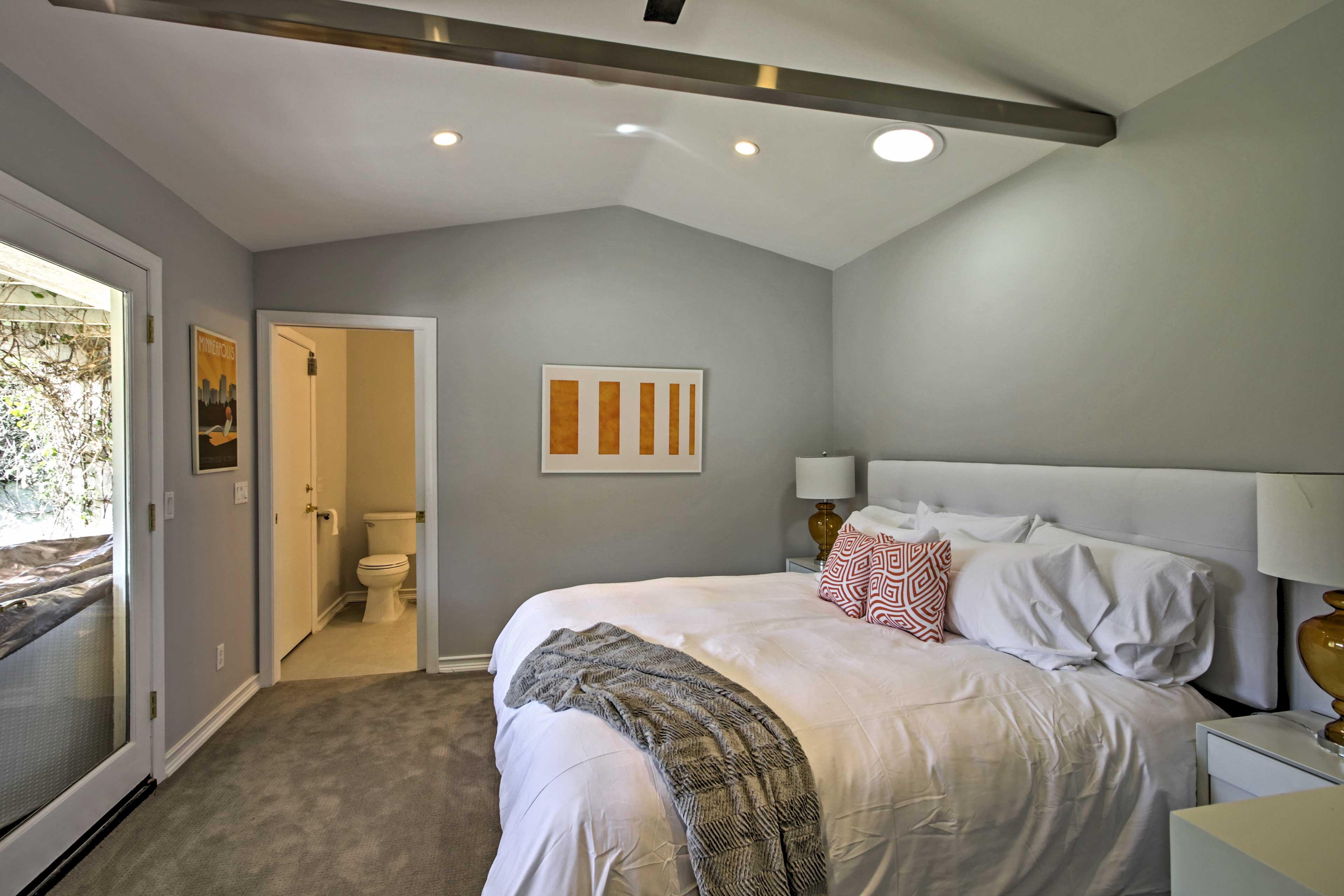 This bedroom has an en-suite bathroom and an exposed wood beam inside.