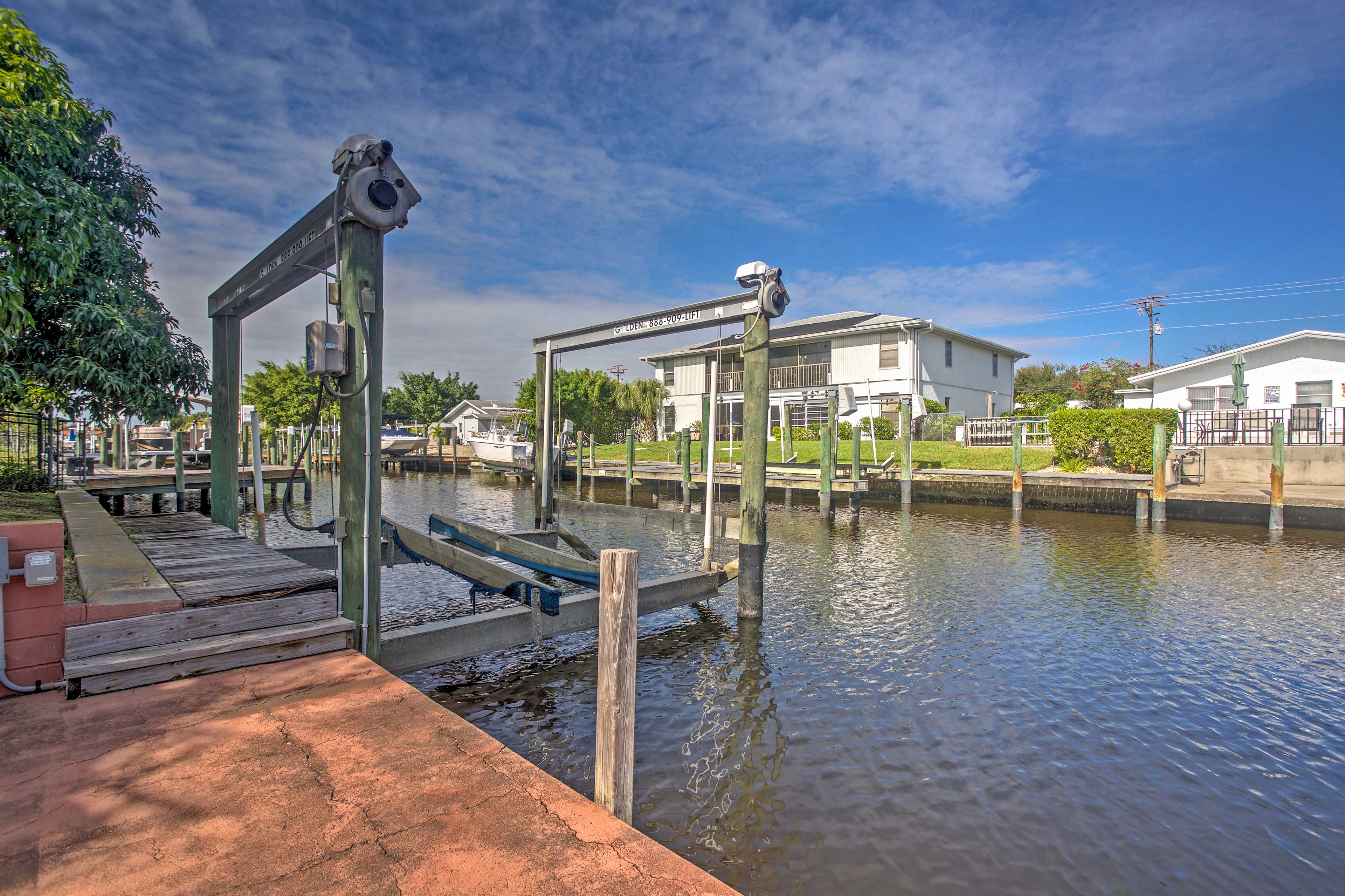 The home sits waterfront on the serene canals of Cape Coral.