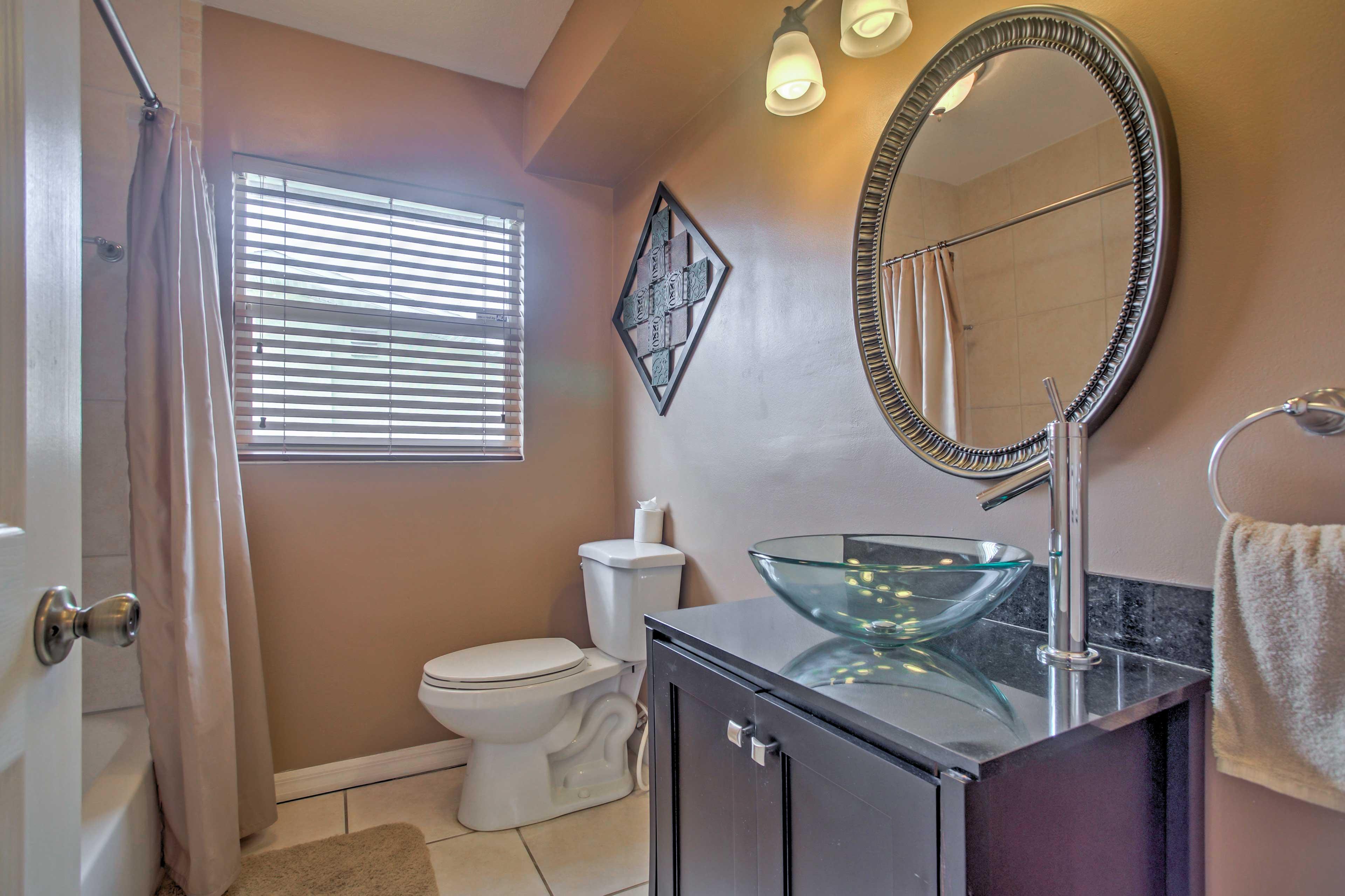 Freshen up in this pristine bathroom!