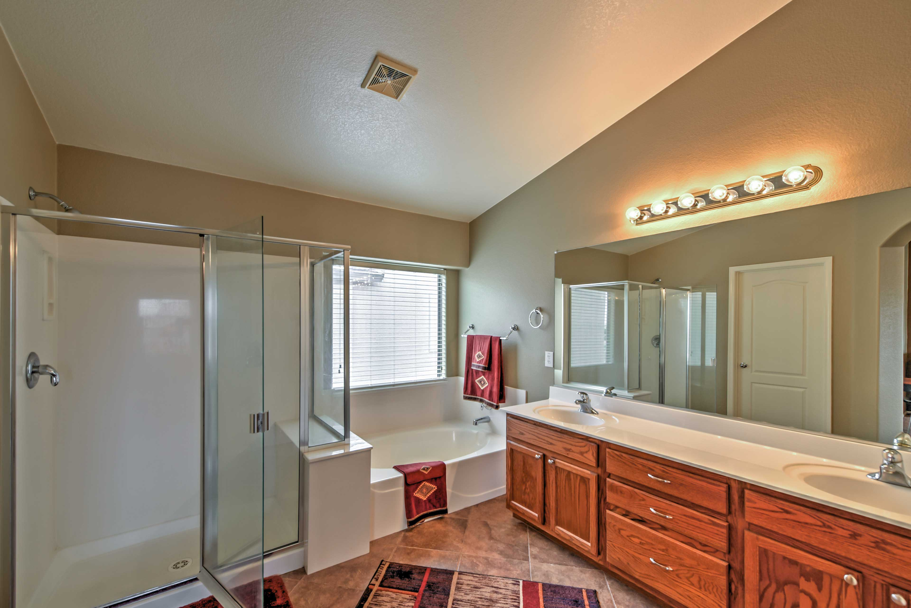 Go for a soak in the tub or rinse off in the walk-in shower - it's up to you!
