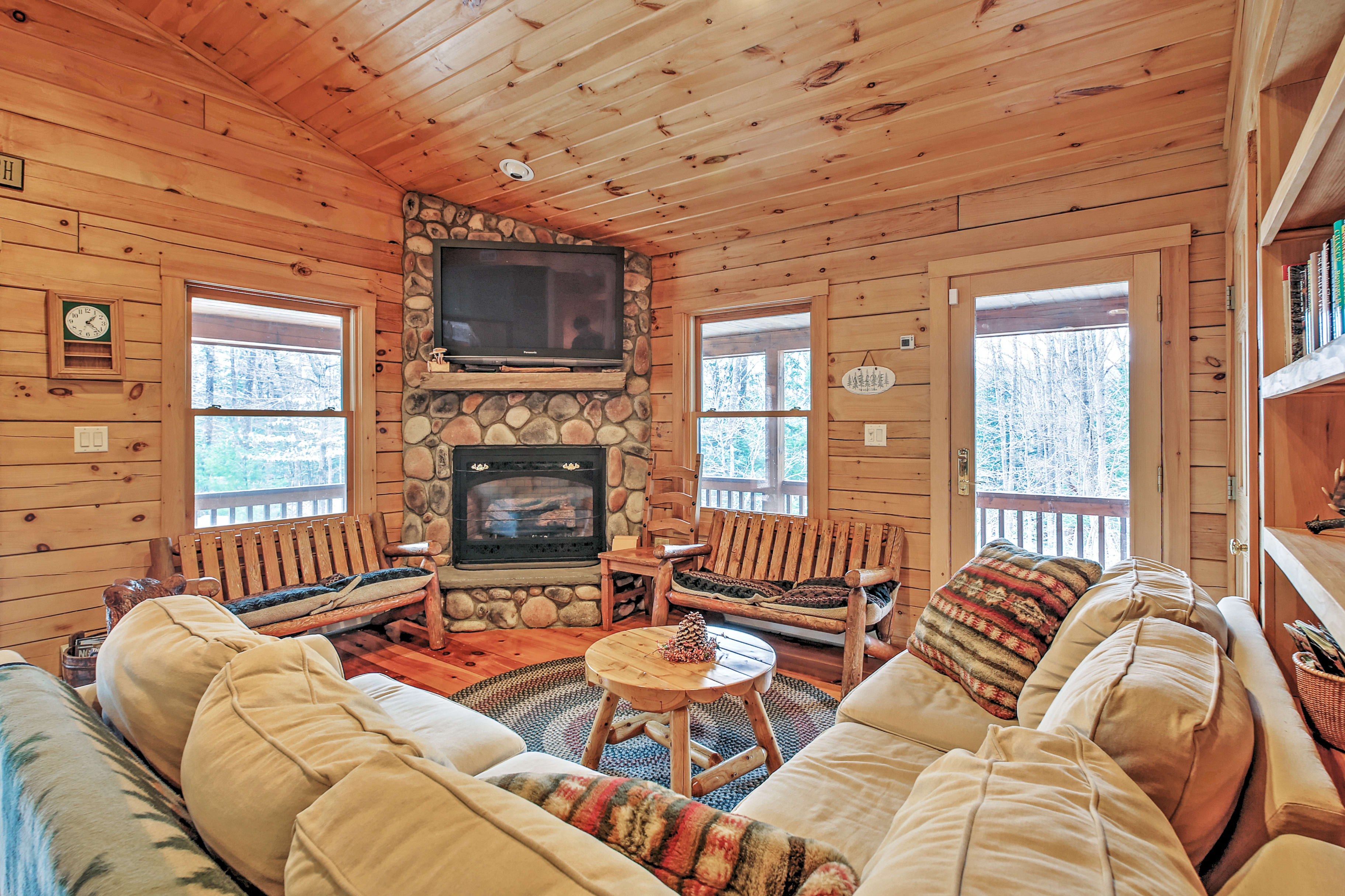 There's plenty of comfortable seating for everyone in this bright living room!