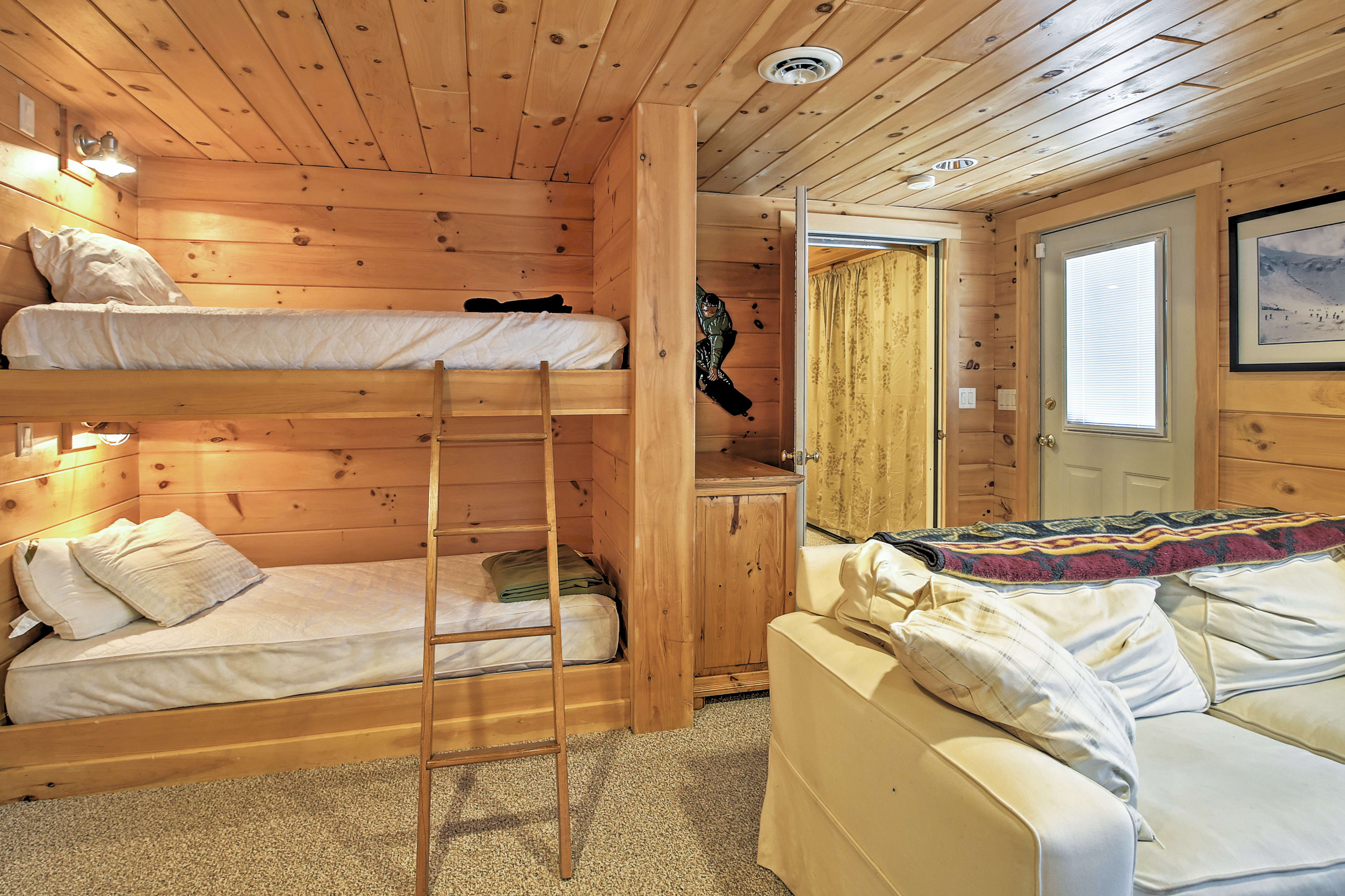 A twin-over-twin bunk bed in the downstairs living area offers additional sleeping for kids.