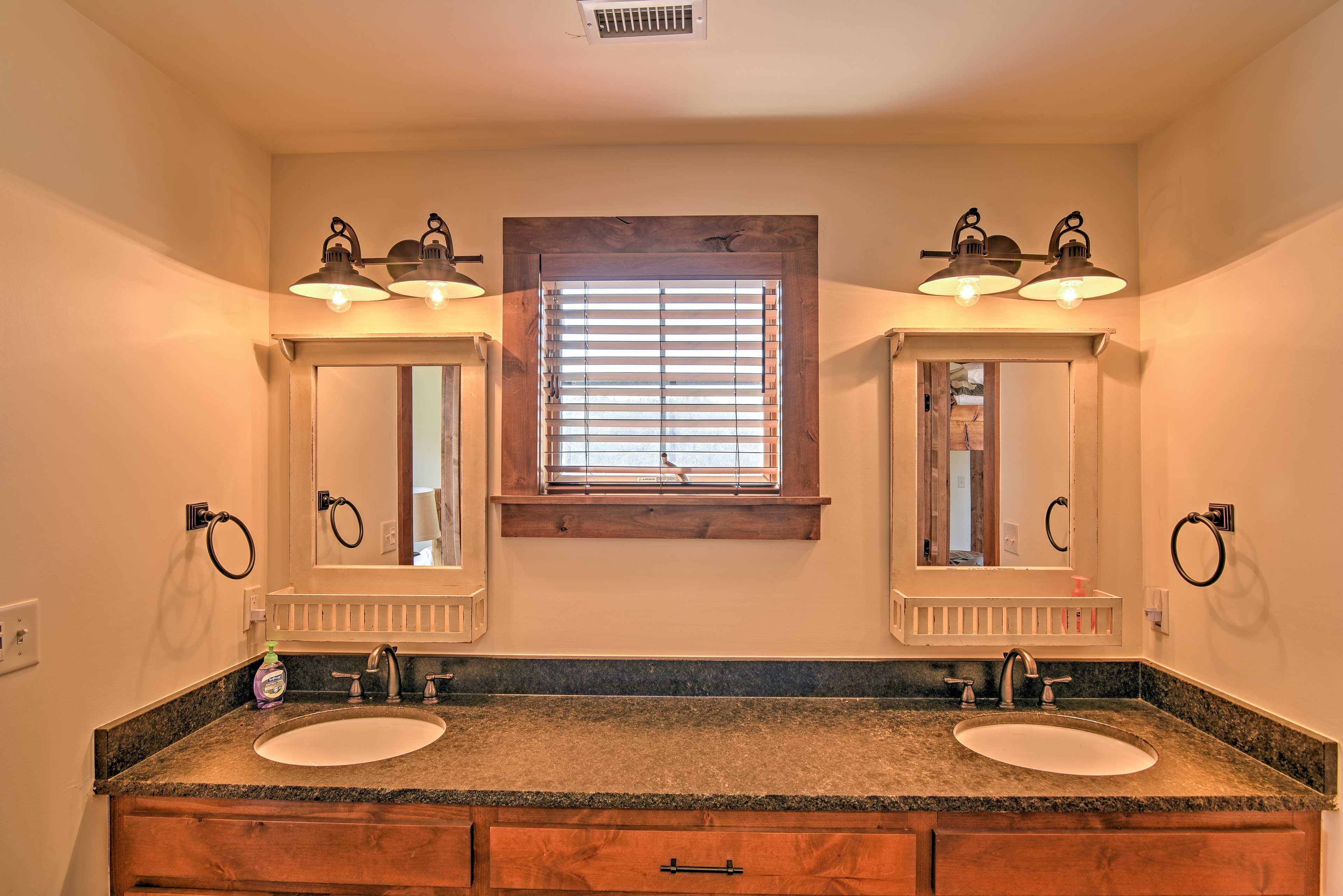 Enjoy plenty of counterspace offered by this luxurious bathroom.