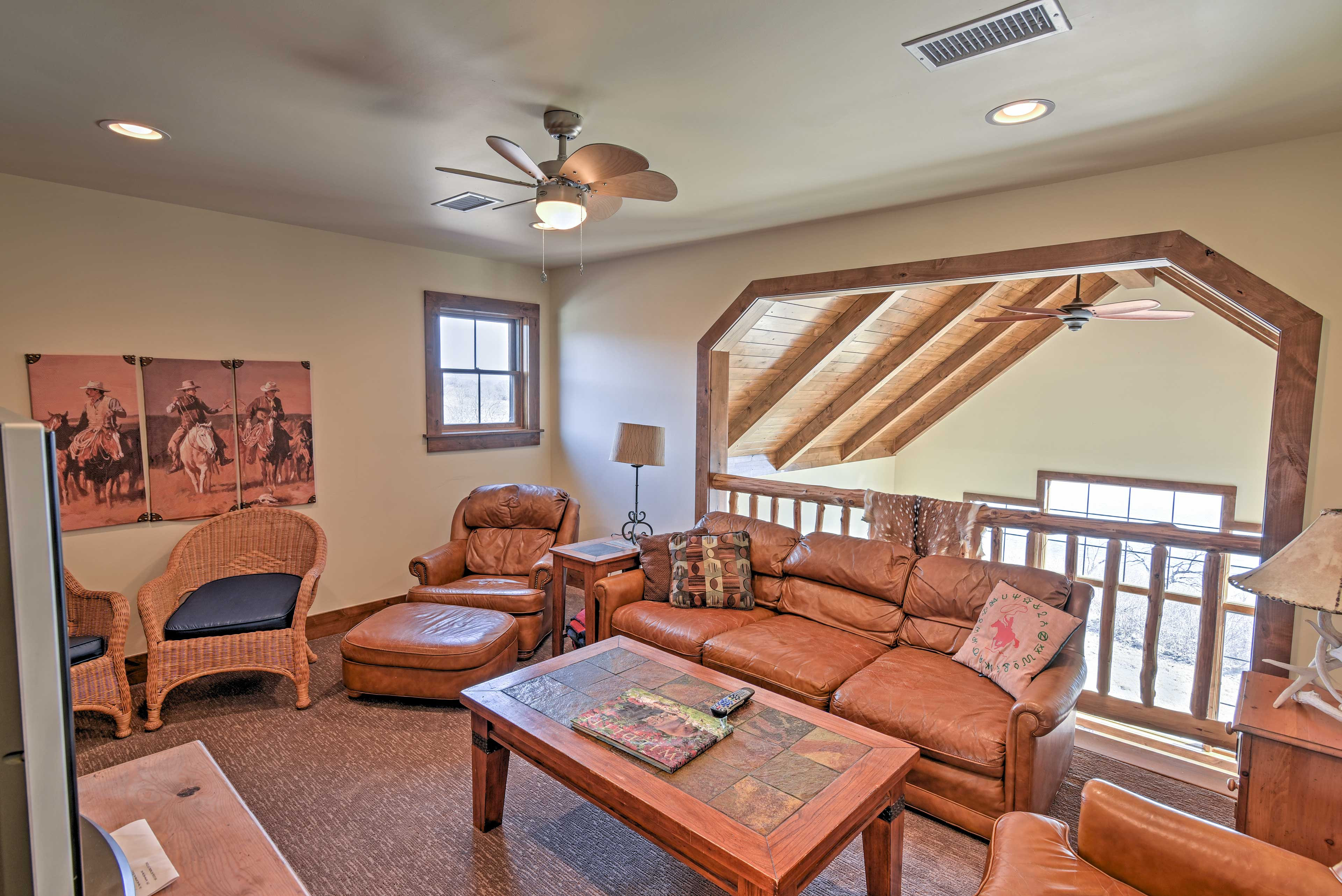 Gaze over the expansive great room from the upper-level loft.