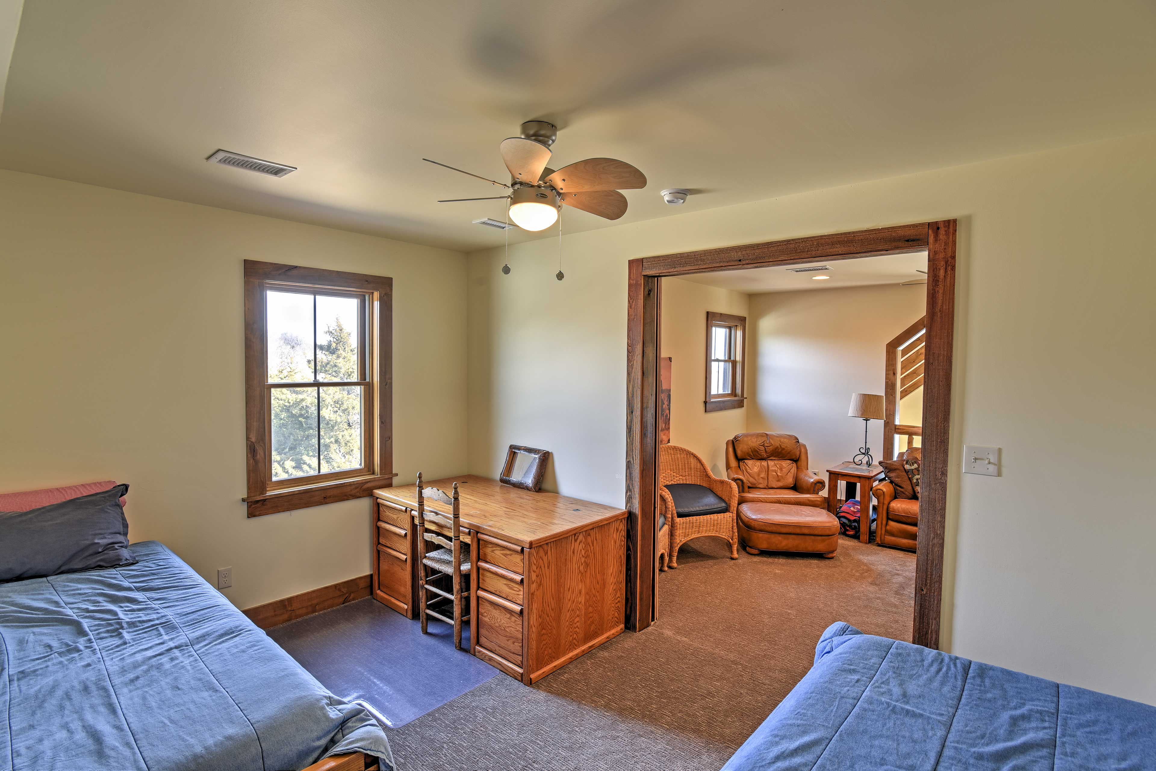 The final bedroom has 2 plush twin mattresses and a desk.