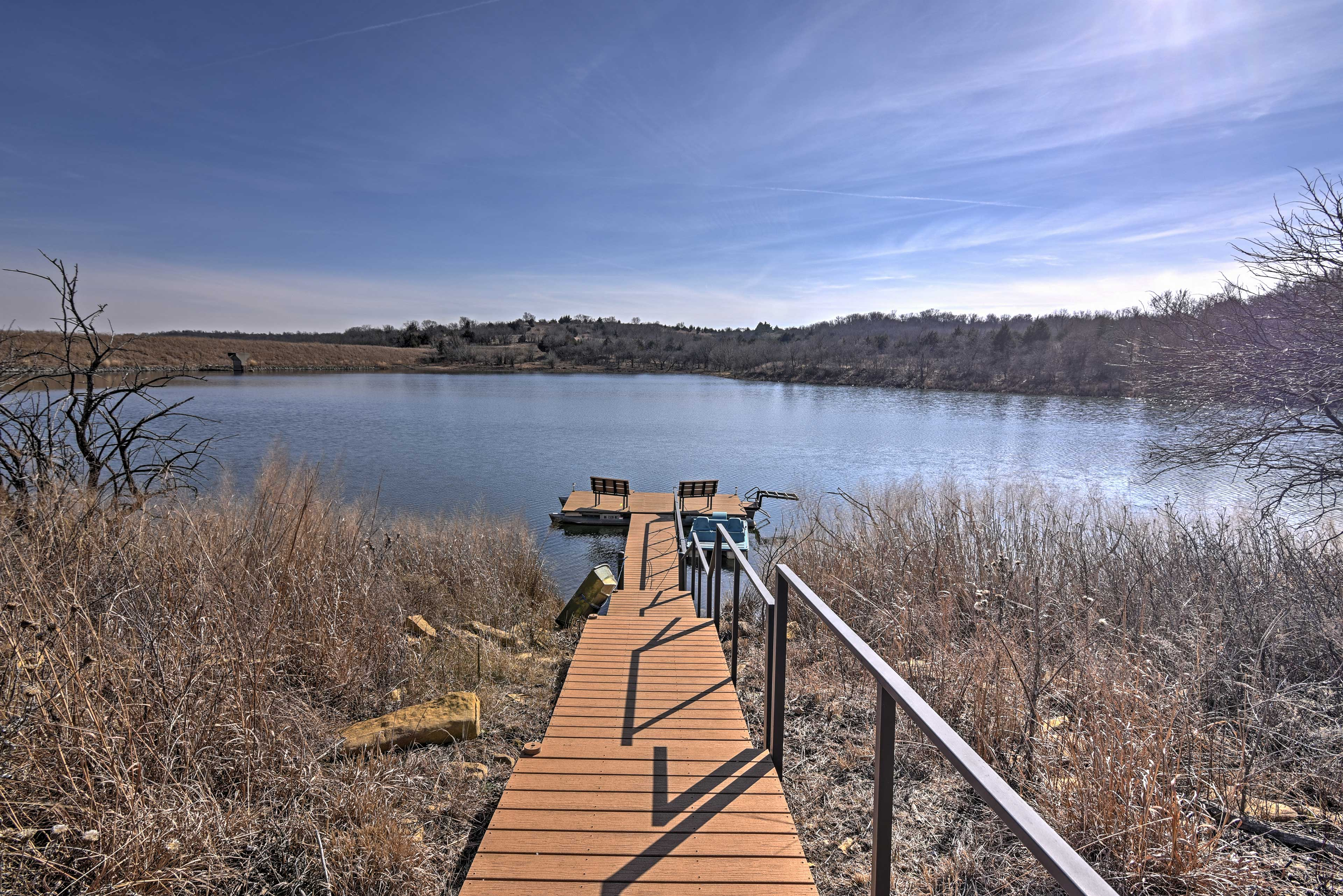 Soak up the sun on the dock of this 4-bedroom Cedar Vale vacation rental lodge.