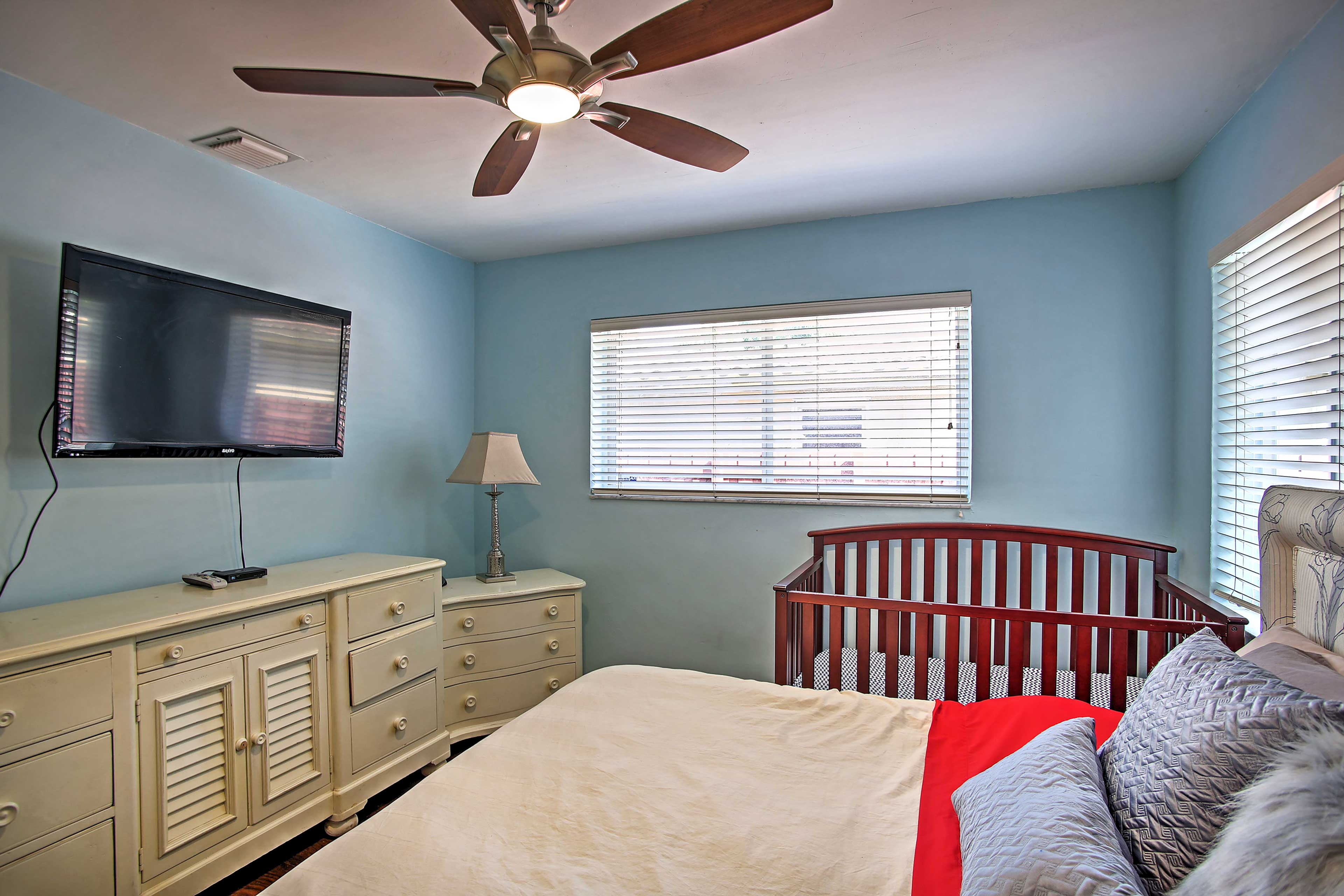 This bedroom has a crib for added convenience.
