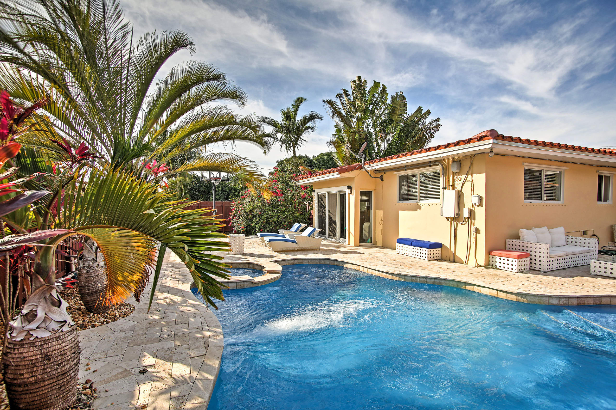 Enjoy the heated pool and hot tub at this vacation rental home in Hollywood!