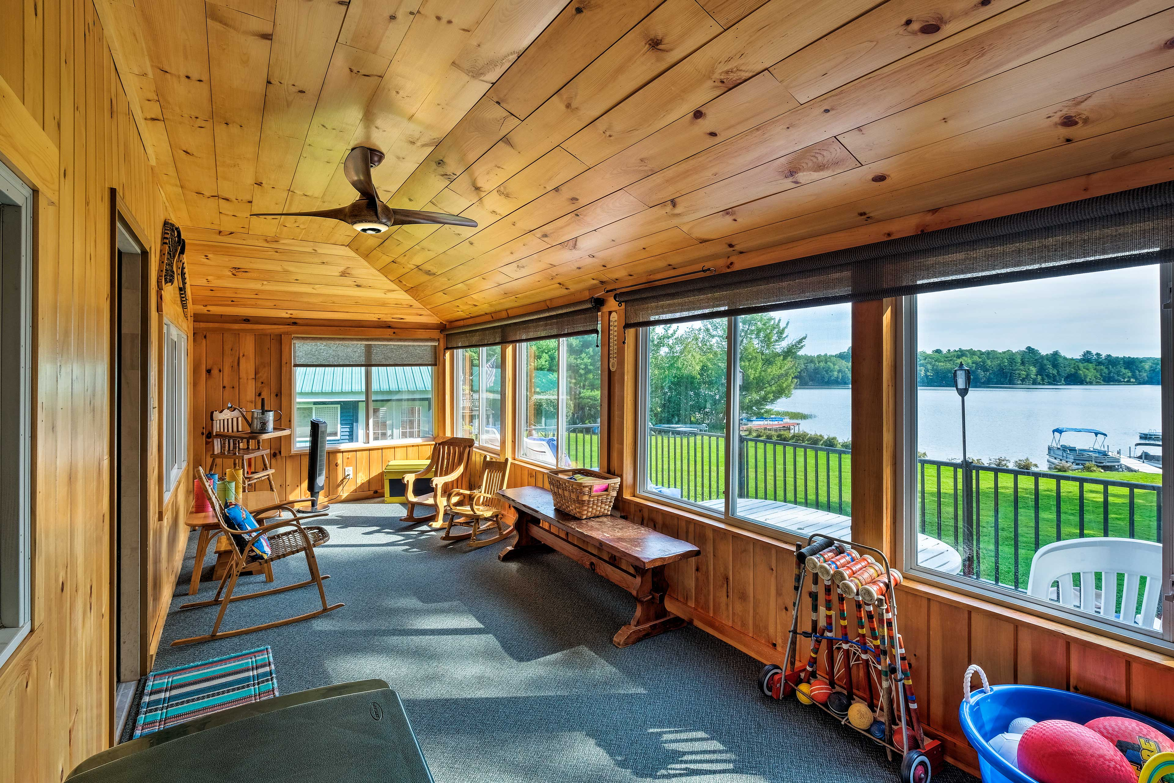 Sit out on the covered porch and enjoy views of the water.