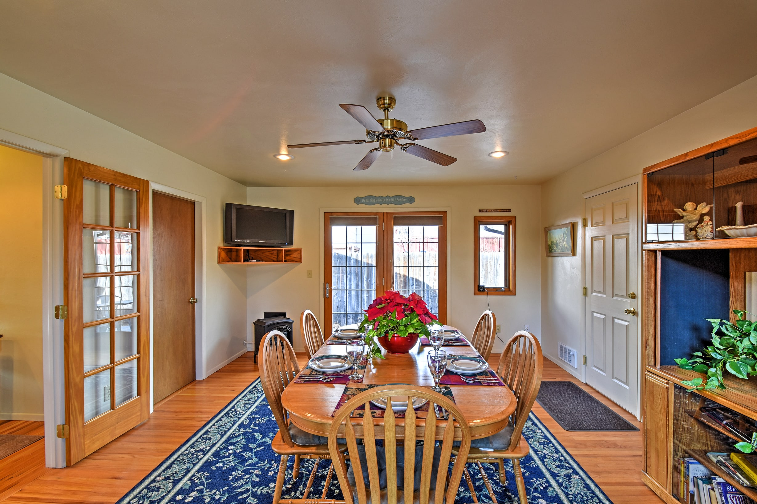 Gather around the lovely dining table with seating for 10 to enjoy your meals.