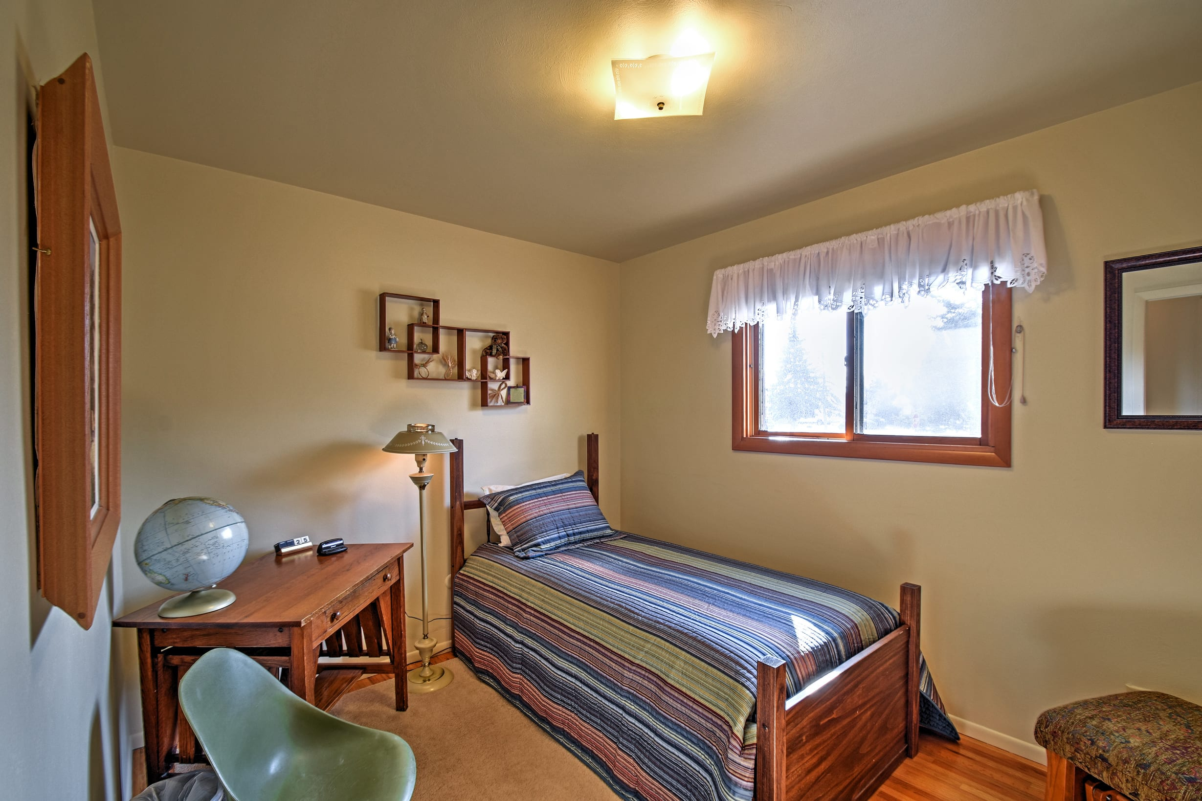 Rise and shine to ample natural sunlight flooding into the room.