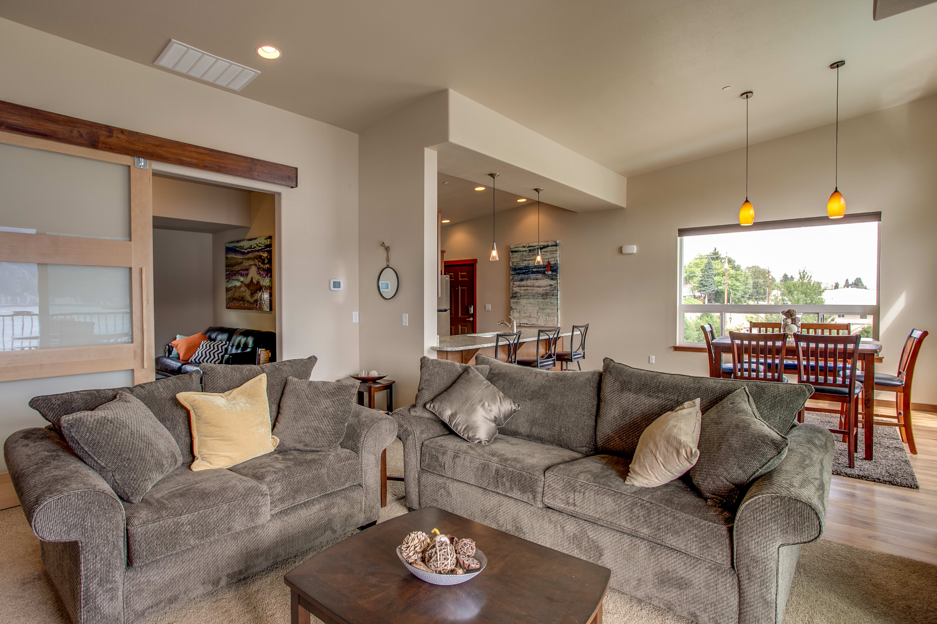 Kick back on the plush living room couches.
